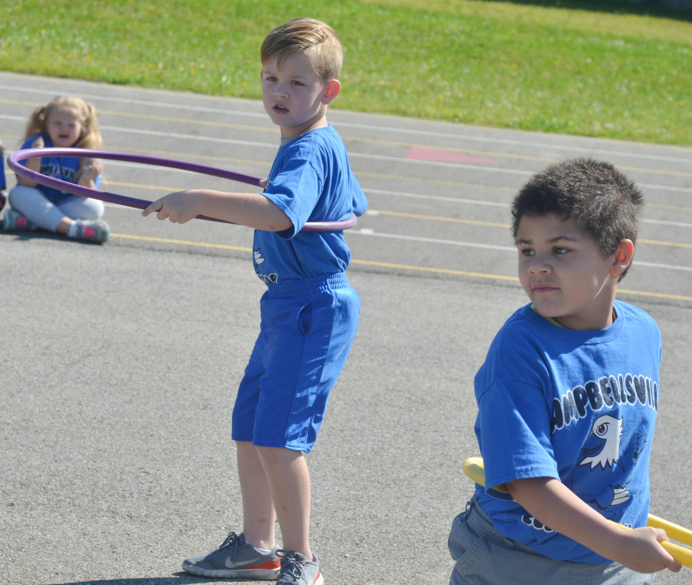 CES kindergarteners John Hagan Newton, at left, and NyJah Vaught get ready for the hula hoop competition.