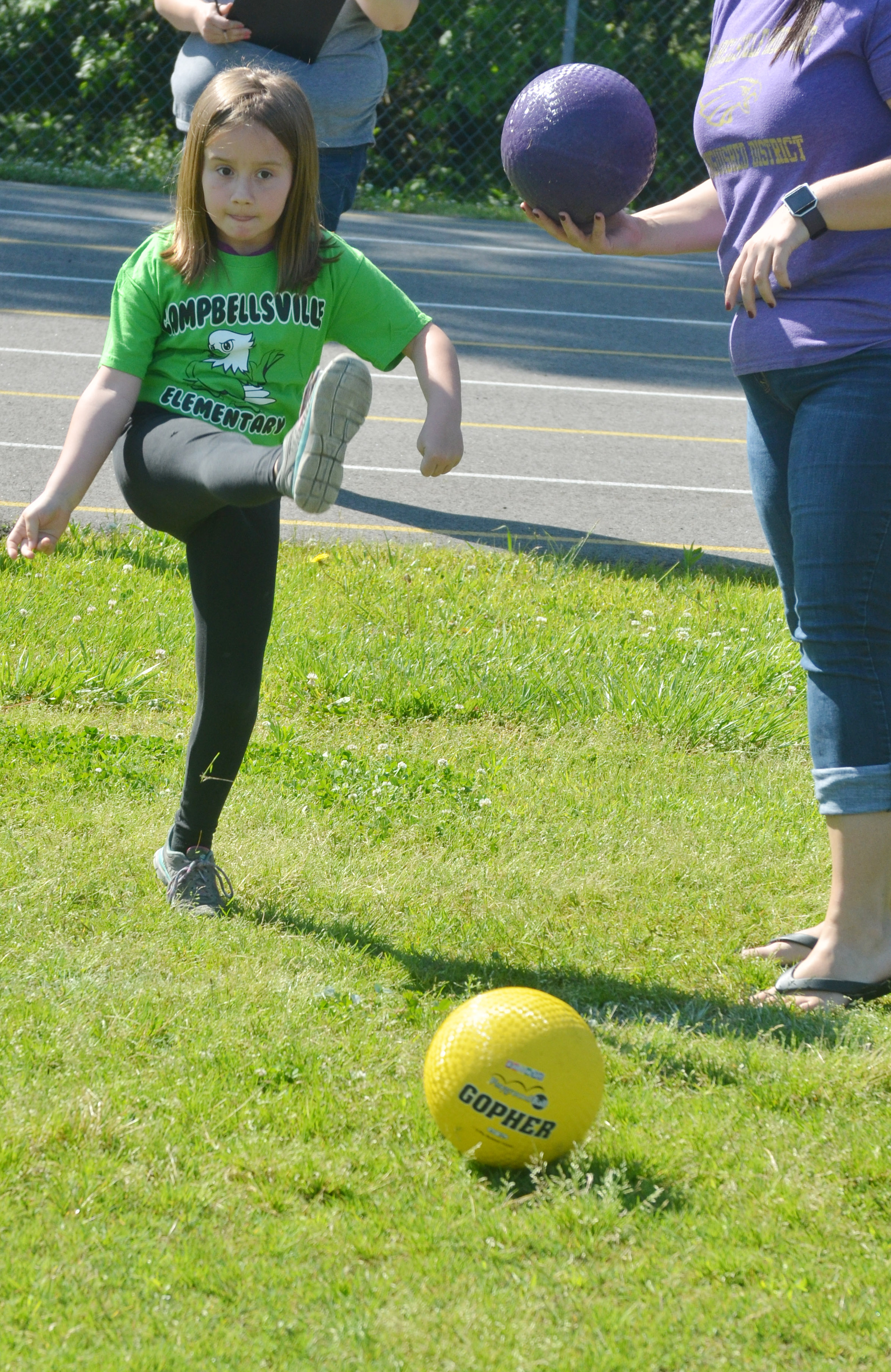 CES kindergartener Natalee Shaw kicks the ball.
