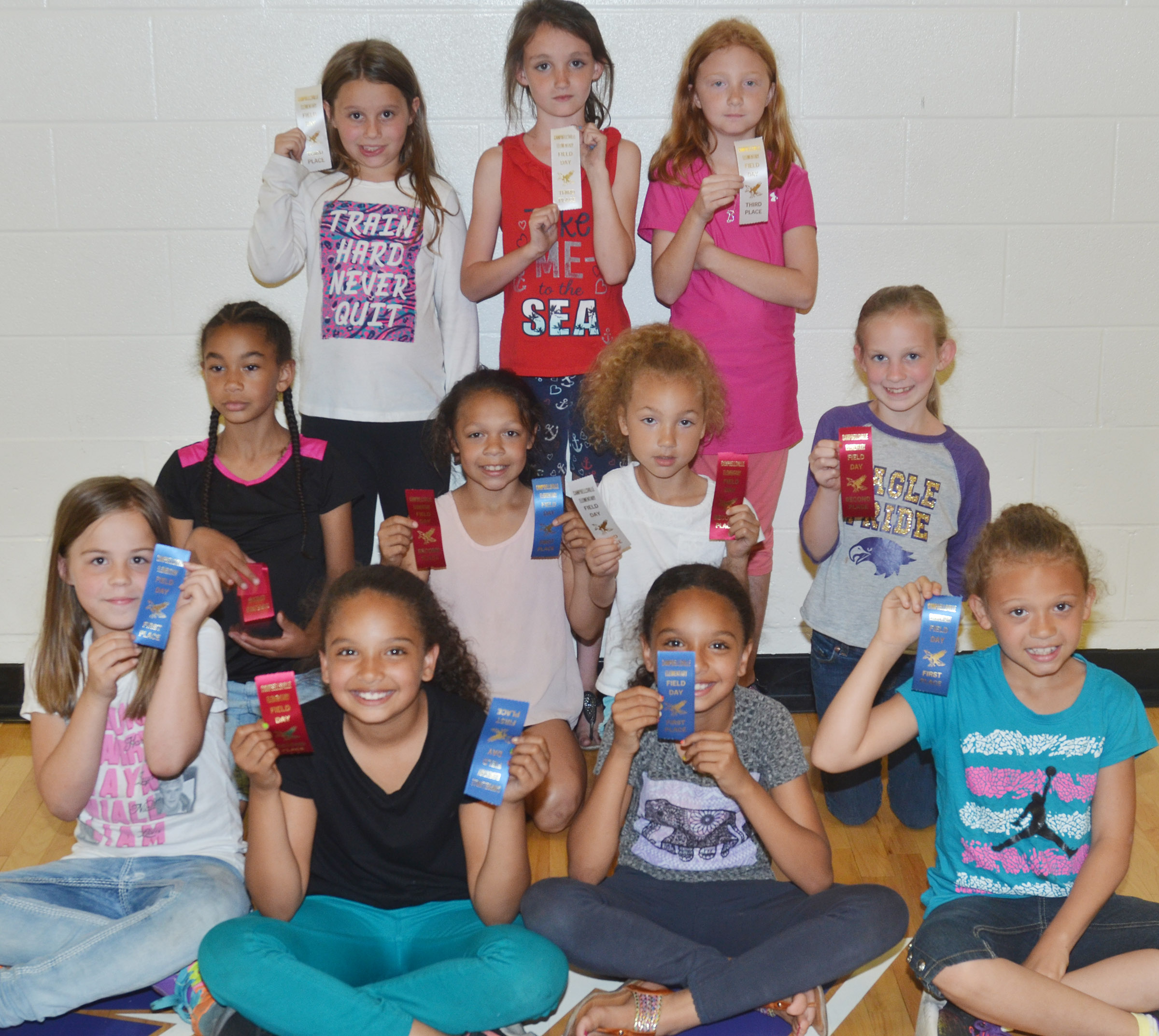 CES third-grade girls who were classroom winners in the 50-yard dash are, from left, front, Chloe Bates, Aleecia Knezevic, Alyssa Knezevic and Alicia Spaulding, first place winners. Second row, De'Asia Fisher, Breona Bridgewater, Raelyn Dunn and Kendall Bright, second place winners. Back, McKailynn Grubaugh, Paige Ritchie and Savannah Wethington, third place winners. Absent from the photo is Madie Gebler, who was a third place winner. Overall, Breona Bridgewater was first, Aleecia Knezevic was second and Raelyn Dunn was third.