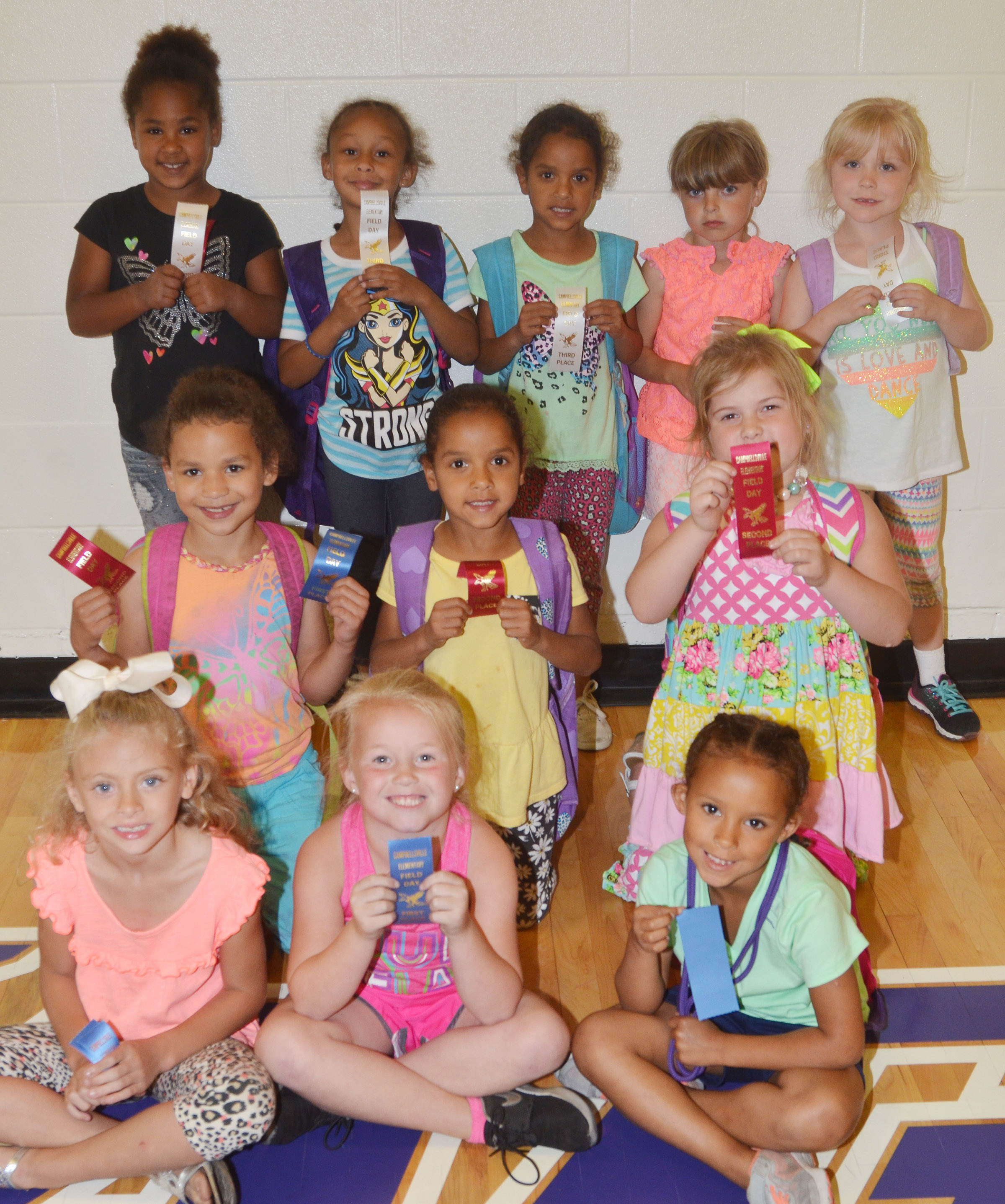 CES kindergarten girls who were classroom winners in the 50-yard dash are, from left, front, Aliyah Litsey, Lillie Judd and Aleja Taylor, who were first place winners. Second row, Aleeya Spaulding, first place winner, and Kylei Thompson and Aubreigh Knifley, who were second place winners. Back, Raelin Goddard, second place winner, and Elyzabeth Fisher, Kaylee Thompson, Madison Wilhoite and Ava Bennett-Marr, who were third place winners. Absent from the photo is Hannah Matias, who was a second place winner. Overall, Aliyah Litsey was first, Aleeya Spaulding was second and Raelin Goddard was third.