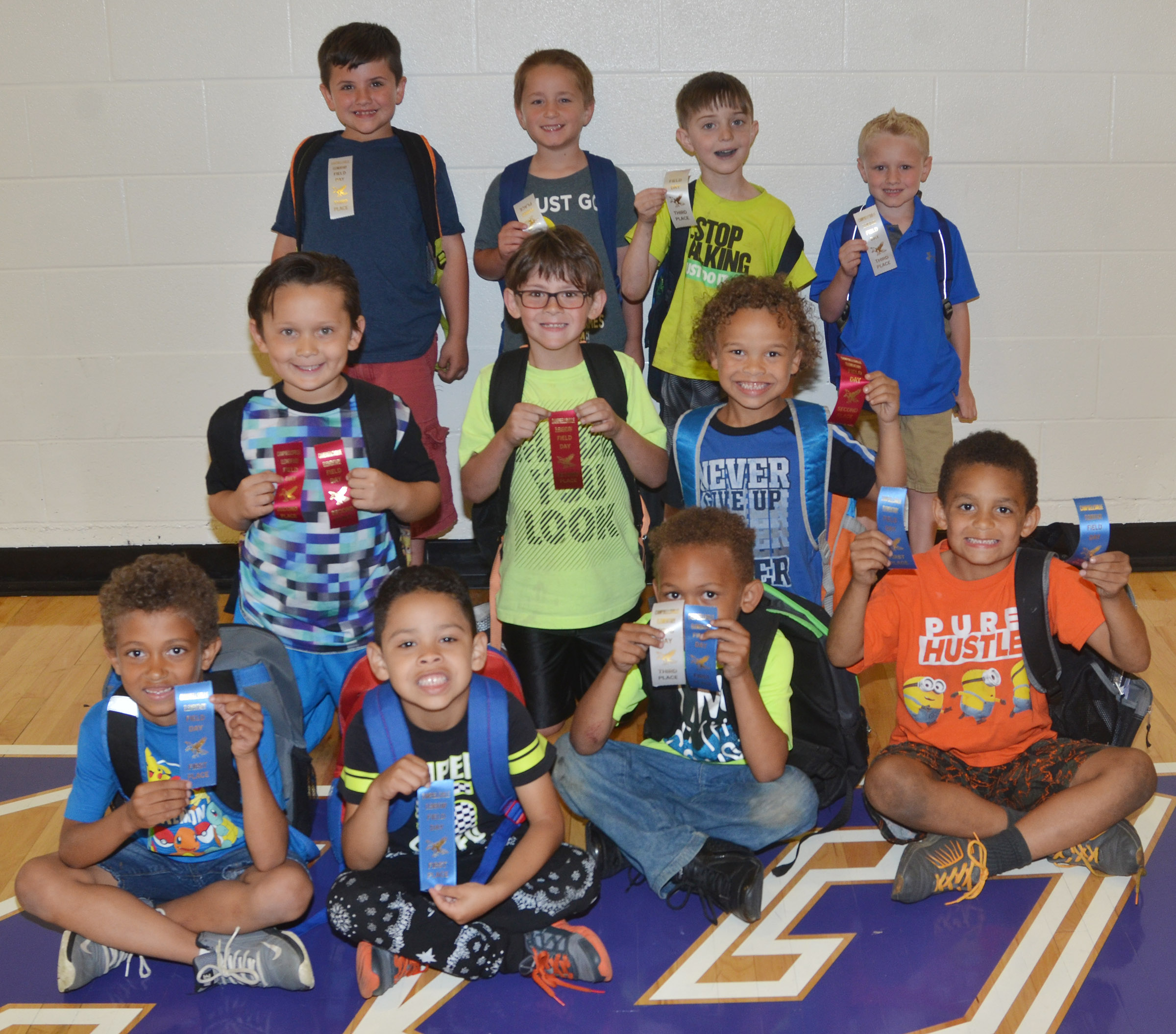 CES kindergarten boys who were classroom winners in the 50-yard dash are, from left, front, Tyce Owens, Demarcus Noyola, Treshaun Robinson and Quincy Travis, who were first place winners. Second row, Karter Young, Bentley Shively and Dyra Welch, who were second place winners. Back, Casen Meredith, Kaiden Bradfield, Caleb Goodson and Jackson Wright, who were third place winners. Absent from the photo is second place winner Zane Mullins. Overall, Quincy Travis was first, Karter Young was second and Treshaun Robinson was third.