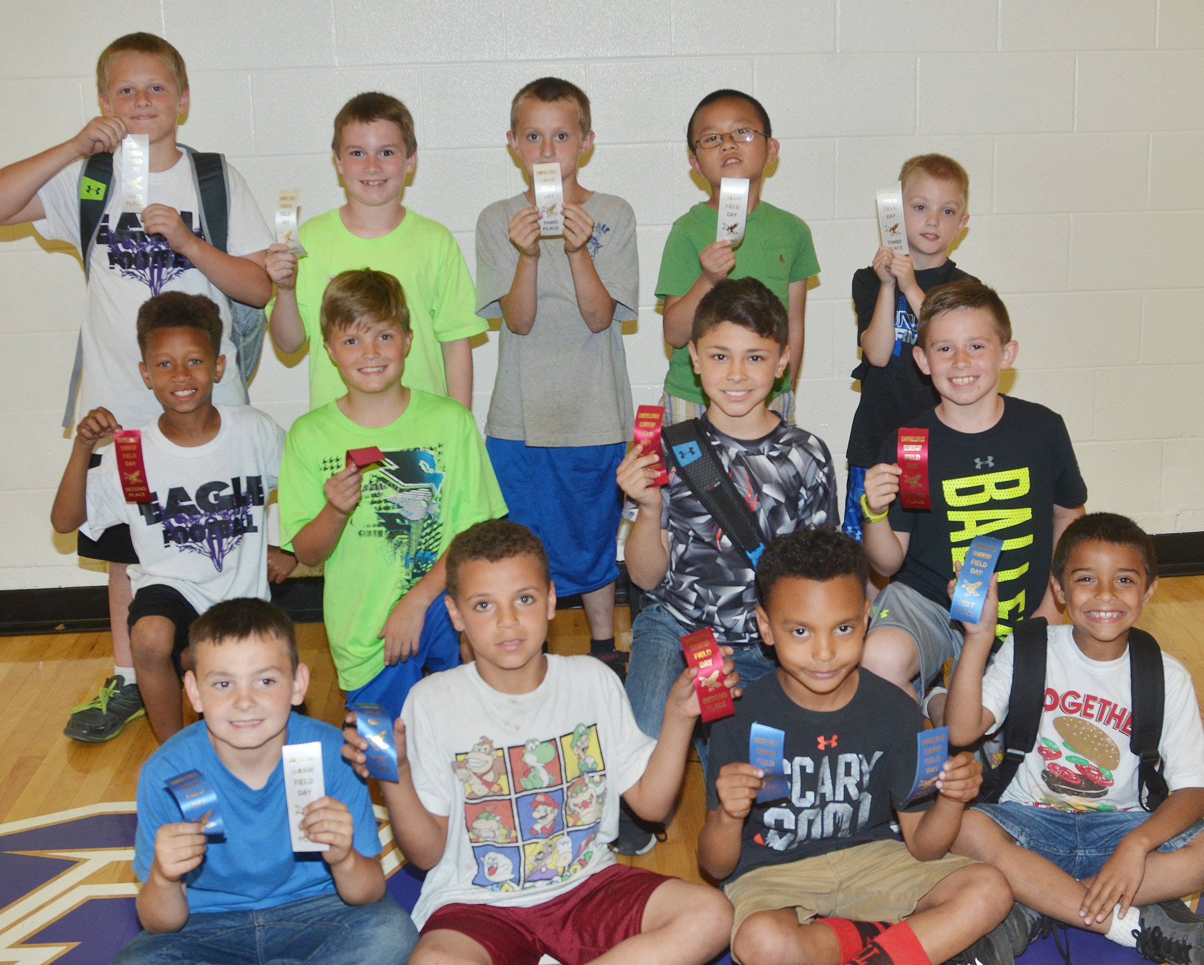 CES second-grade boys who were classroom winners in the 50-yard dash are, from left, Hunter Garmon, Zayden McKenzie, Maddox Hawkins and Keylan Strong, first place winners. Second row, Rajon Taylor, Emerson Gowin, Braygon Noegel and Lanigan Price, second place winners. Back, Evan Lockridge, Stephen Green, Zachary Cox, Alex Yang and Evan Cundiff, third place winners. Overall, Maddox Hawkins was first, Zayden McKenzie was second and Hunter Garmon was third.