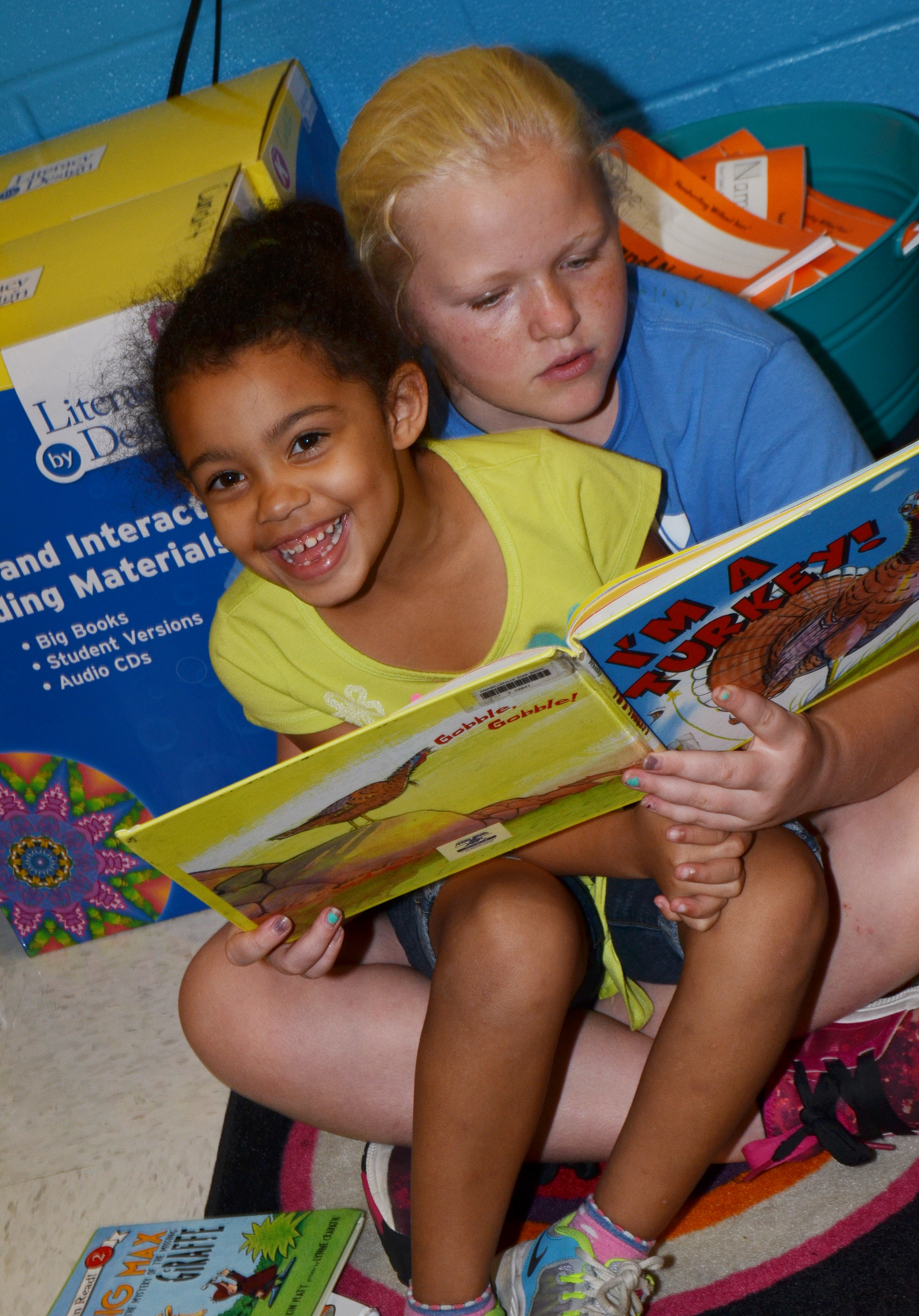 CES fifth-grader Daisy Wilkerson reads to kindergartener Rylee Karr.