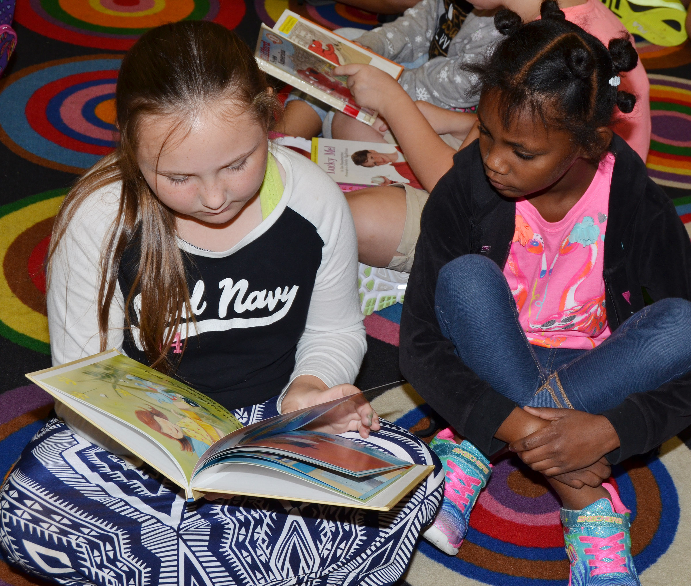 CES fifth-grader Shyanna Young reads to kindergartener Alaina Bridgewater.