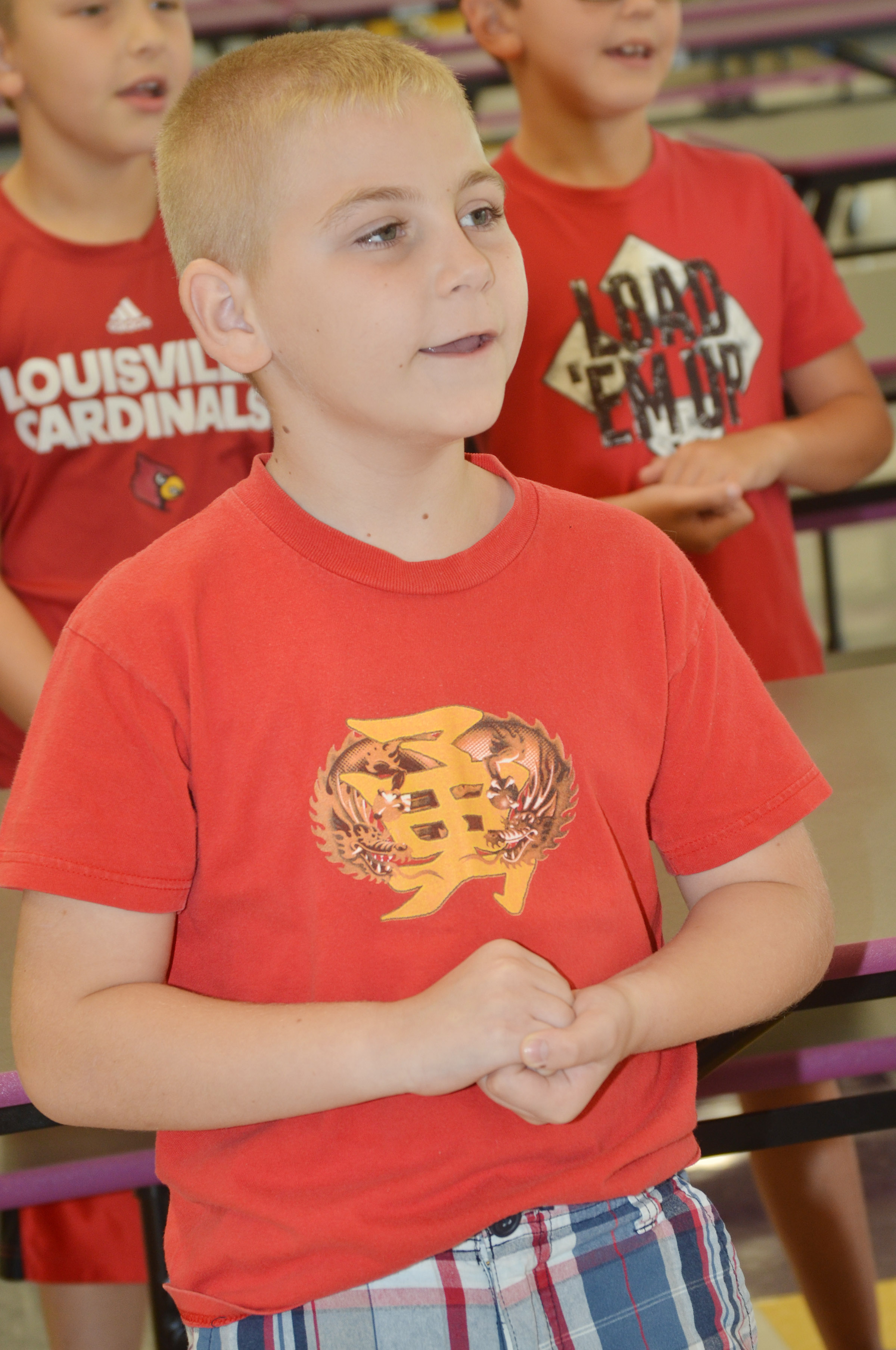 CES third-grader Joseph Greer sings.