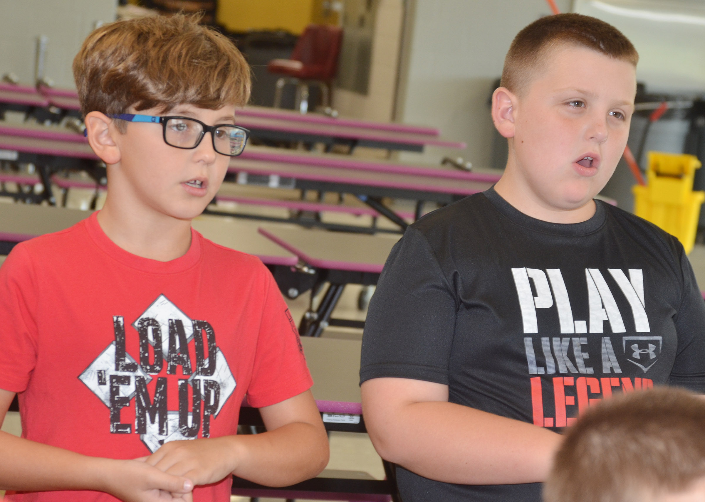 CES third-grader Tye Rhodes, at left, and Braxton Tucker sing.