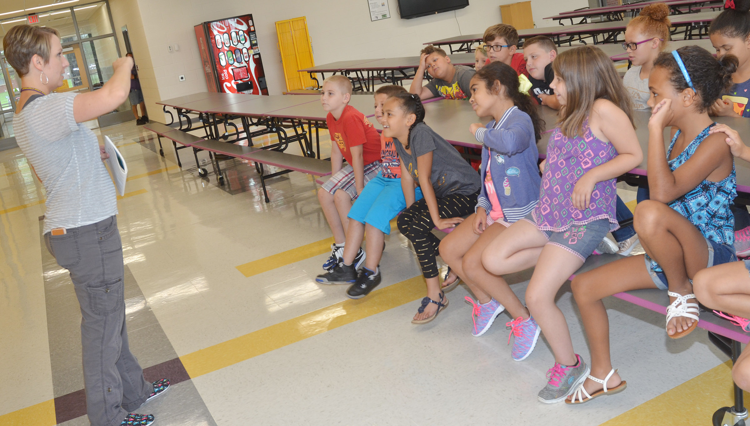 CES third-grade choir director Jessica Floyd leads her students as they sing a warmup exercise.