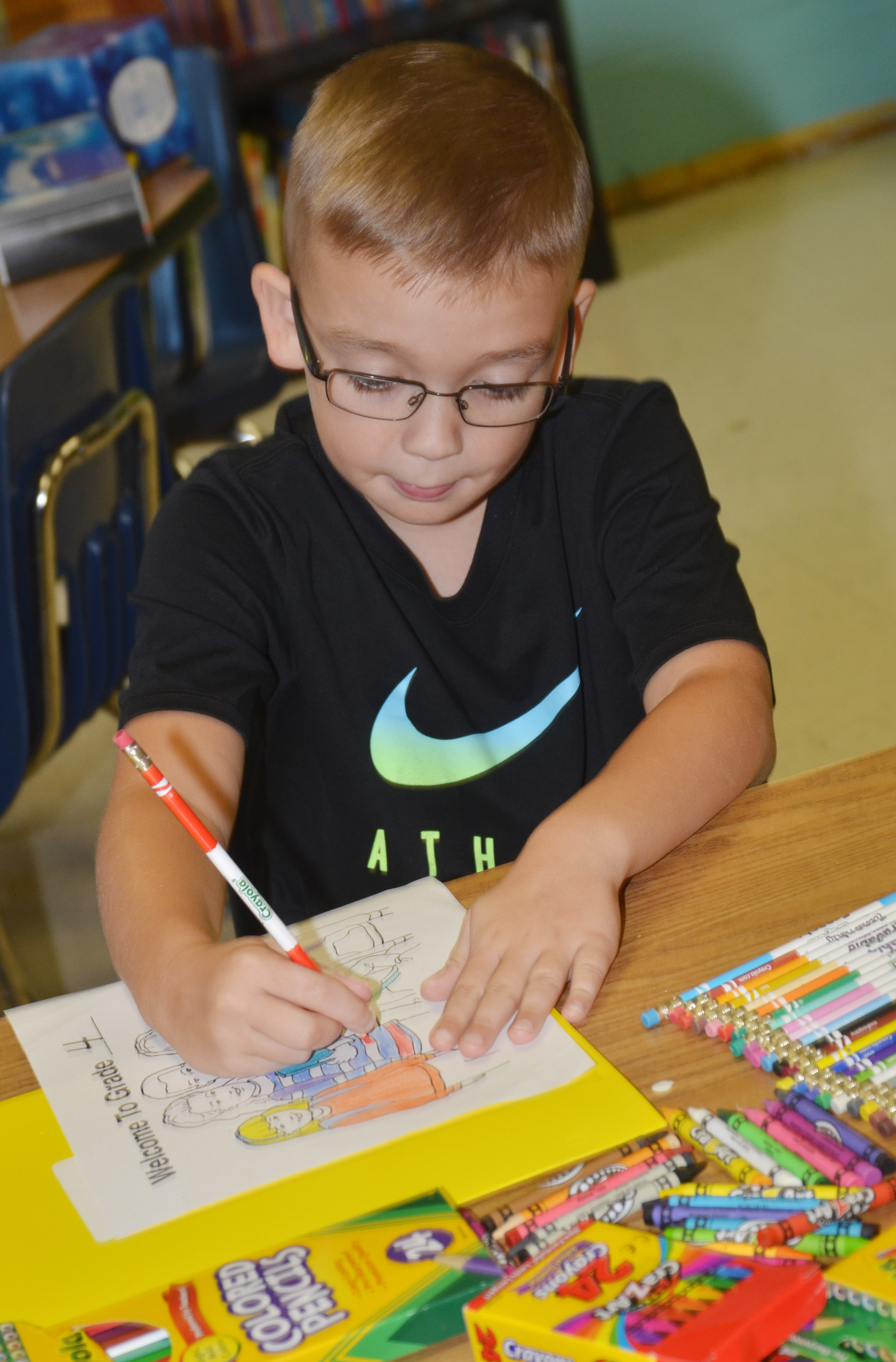 Cameron Estes colors a picture on his first day of fourth grade at CES.