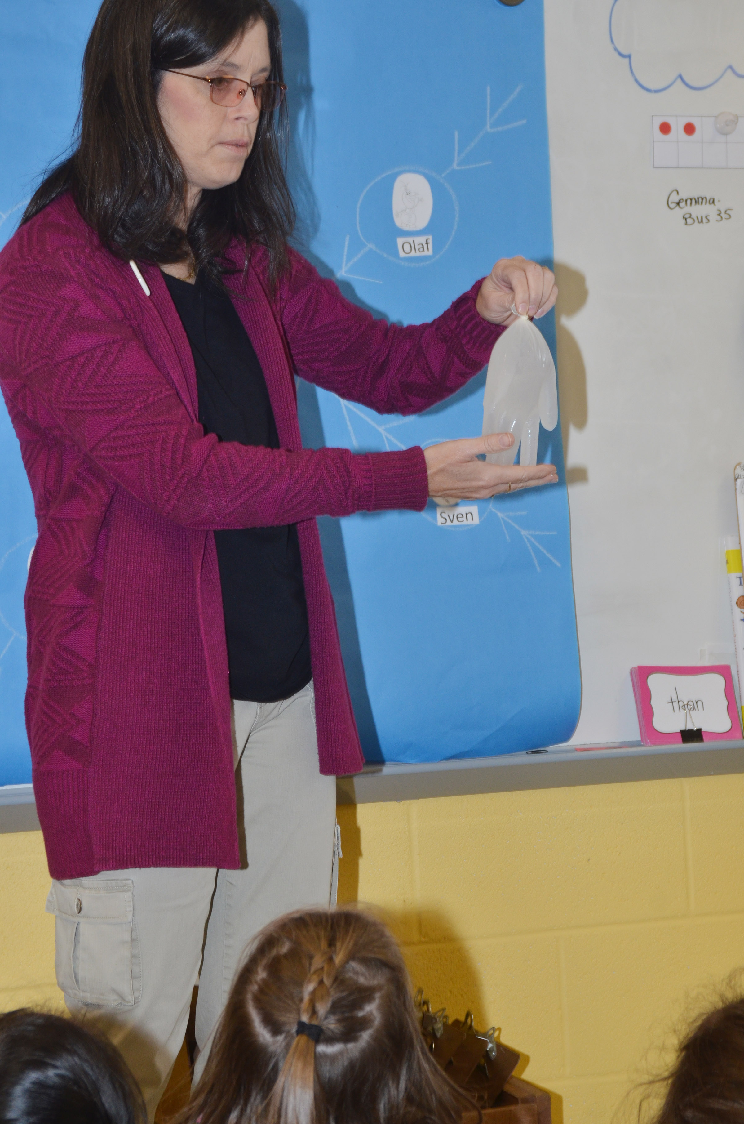 CES first-grade teacher Shirley Cox teaches students about how a liquid can freeze and become a solid.