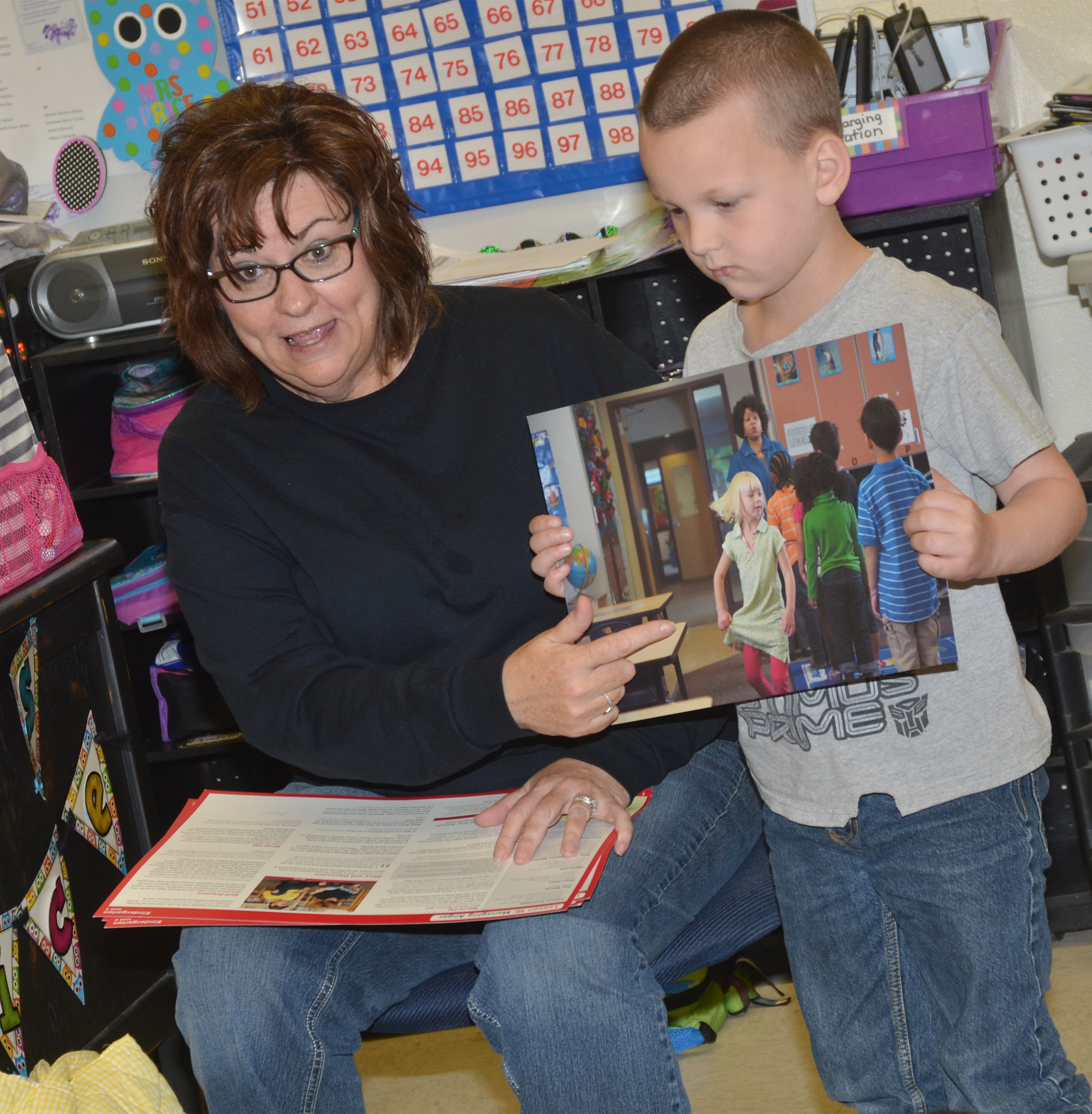 Susan Kennon, a Campbellsville Family Resource and Youth Services Center liaison at CES, with help from kindergartener Justice Nelson, talks to students about what they should do if they feel mad.