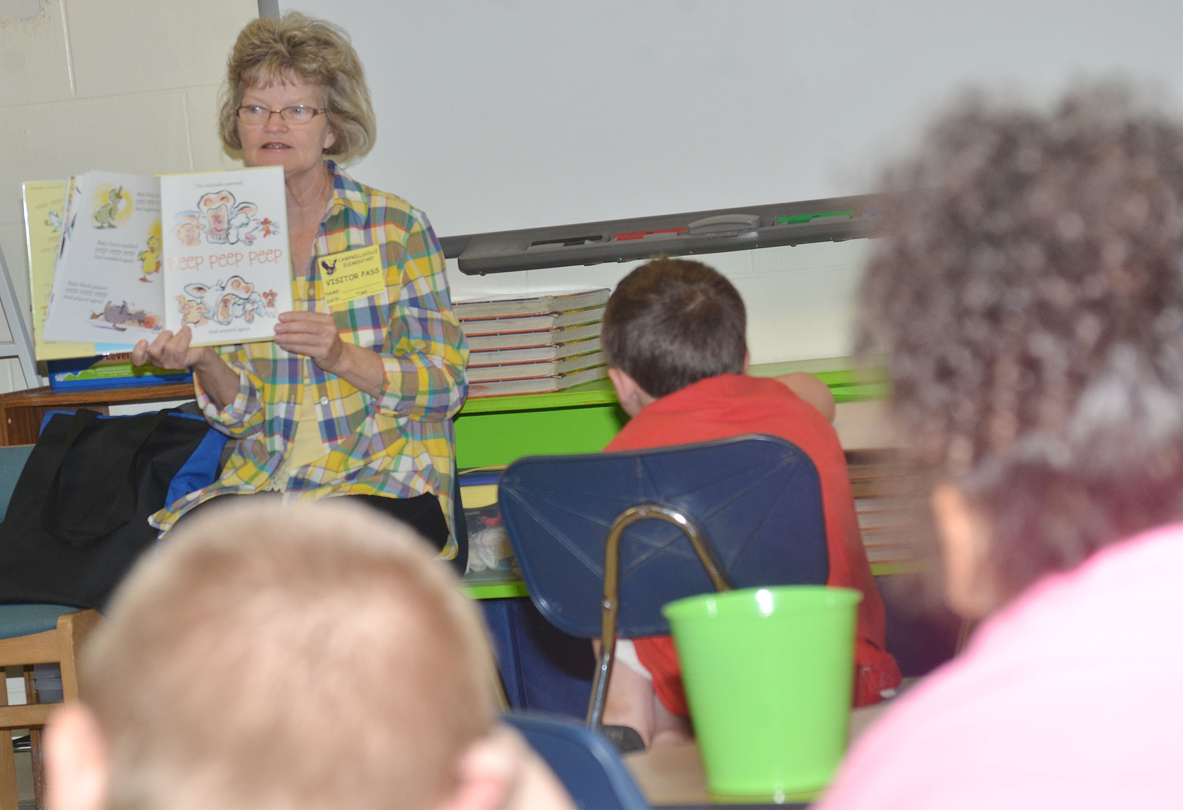 Bonnie Webster reads to CES second-graders.