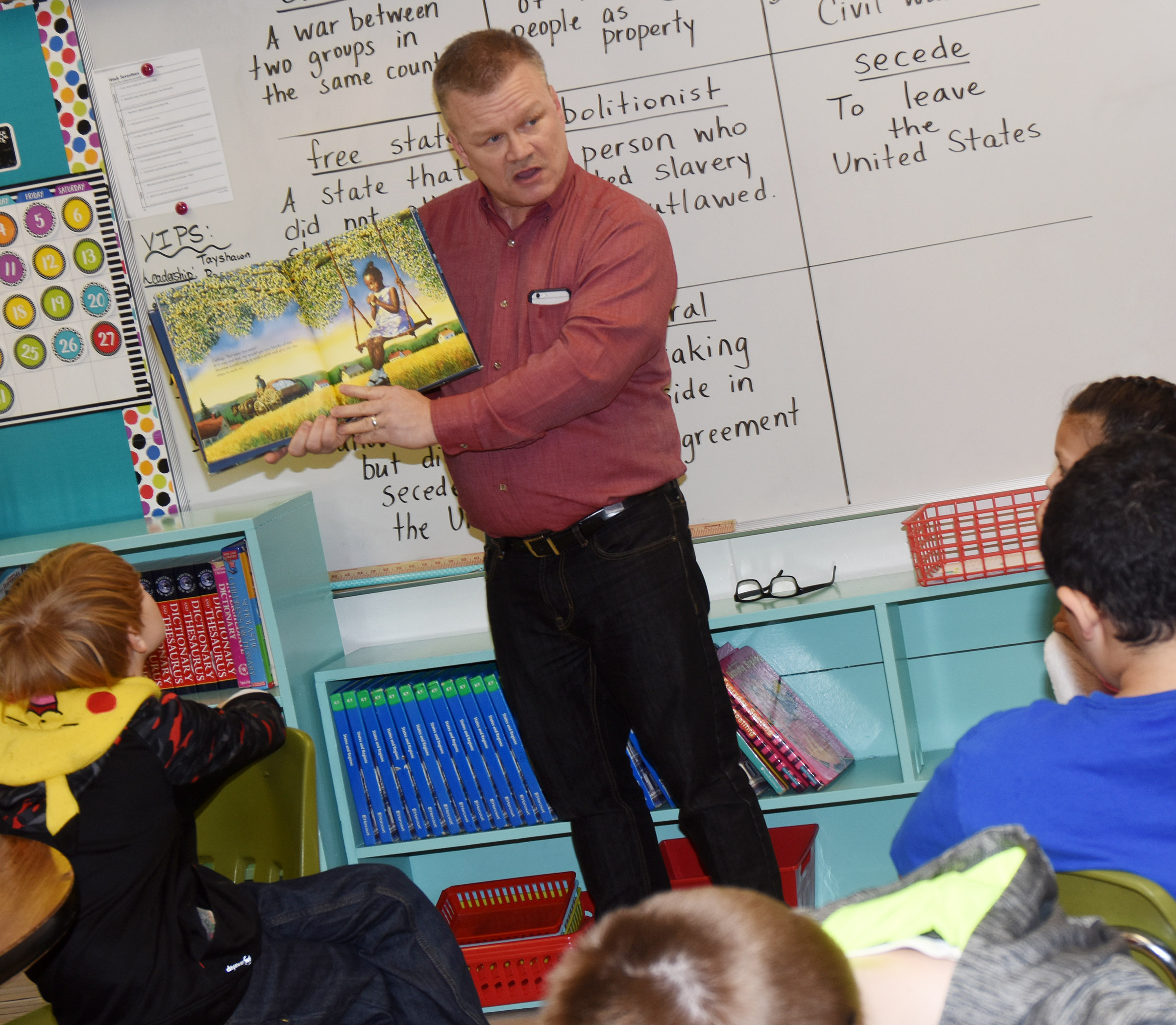 Trent Ford reads to CES fourth-graders.