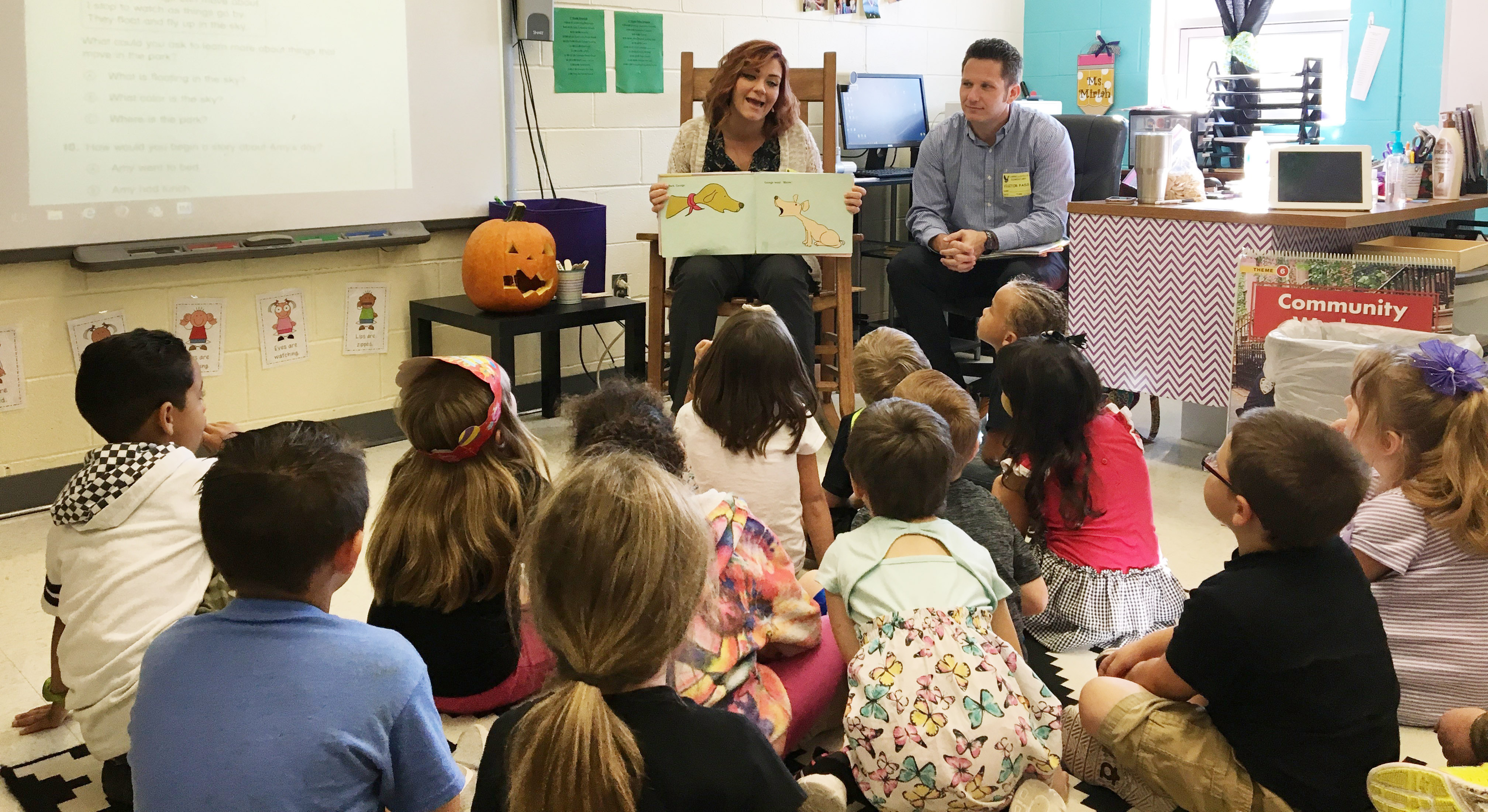 Amanda and Jason Roop read to CES first-graders.
