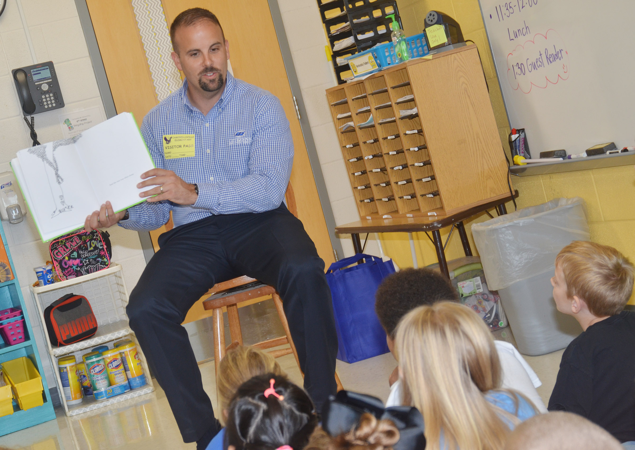 Josh Myers reads to CES second-graders.