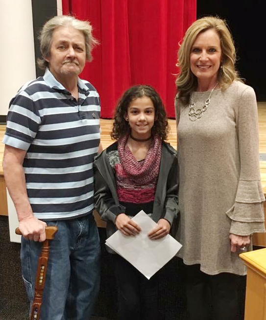 "Campbellsville Elementary School fifth-grader Mackenzie Negron was named a winner in this year's Grandparent of the Year essay contest. She is pictured with her grandfather, Woodford ""Junior"" Bottoms, and Mitzi Tedder, a Taylor County Retired Teachers Association member."