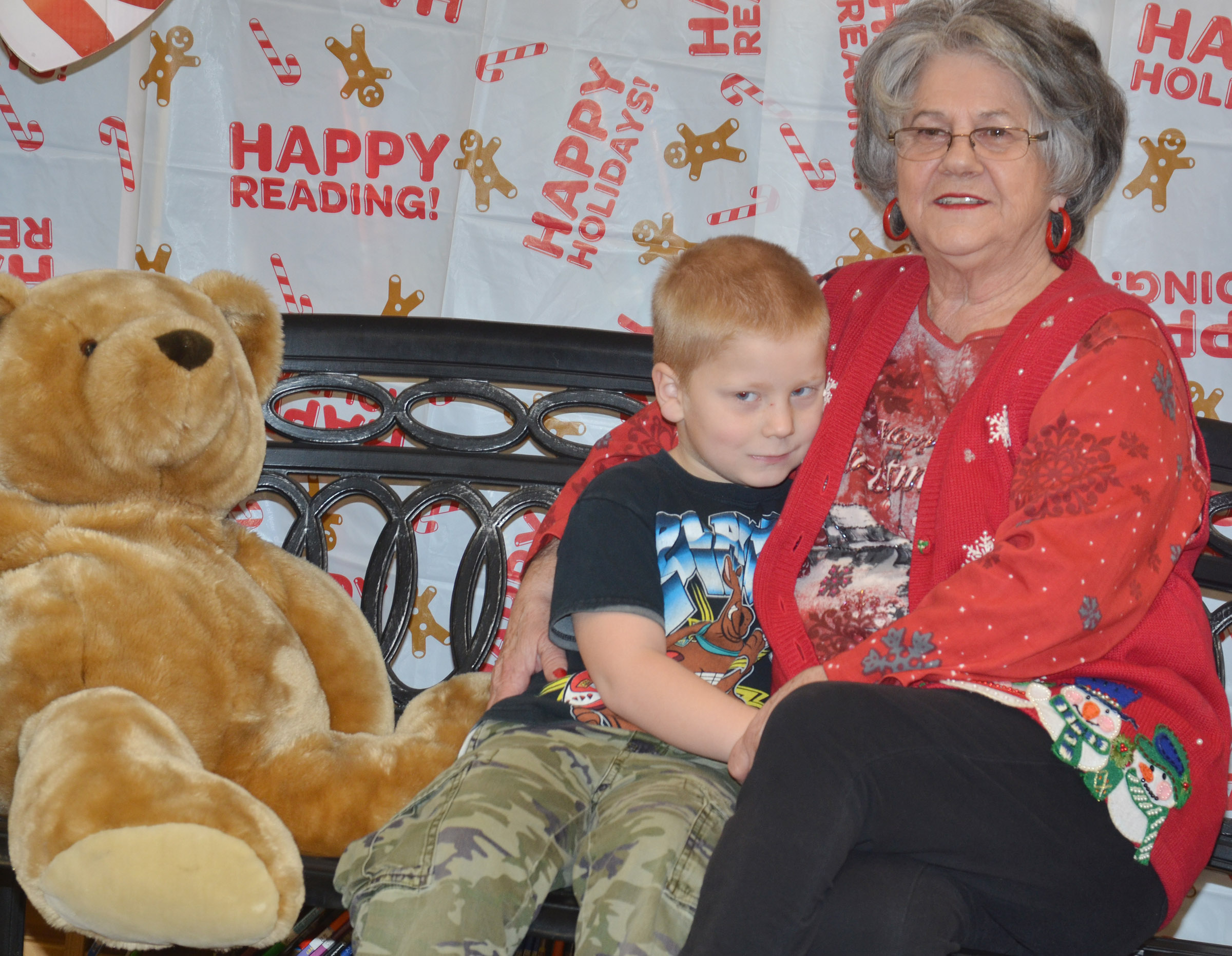 CES first-grader Ben Parrott snuggles with his grandmother, Janis Turner, as they take a photo together.