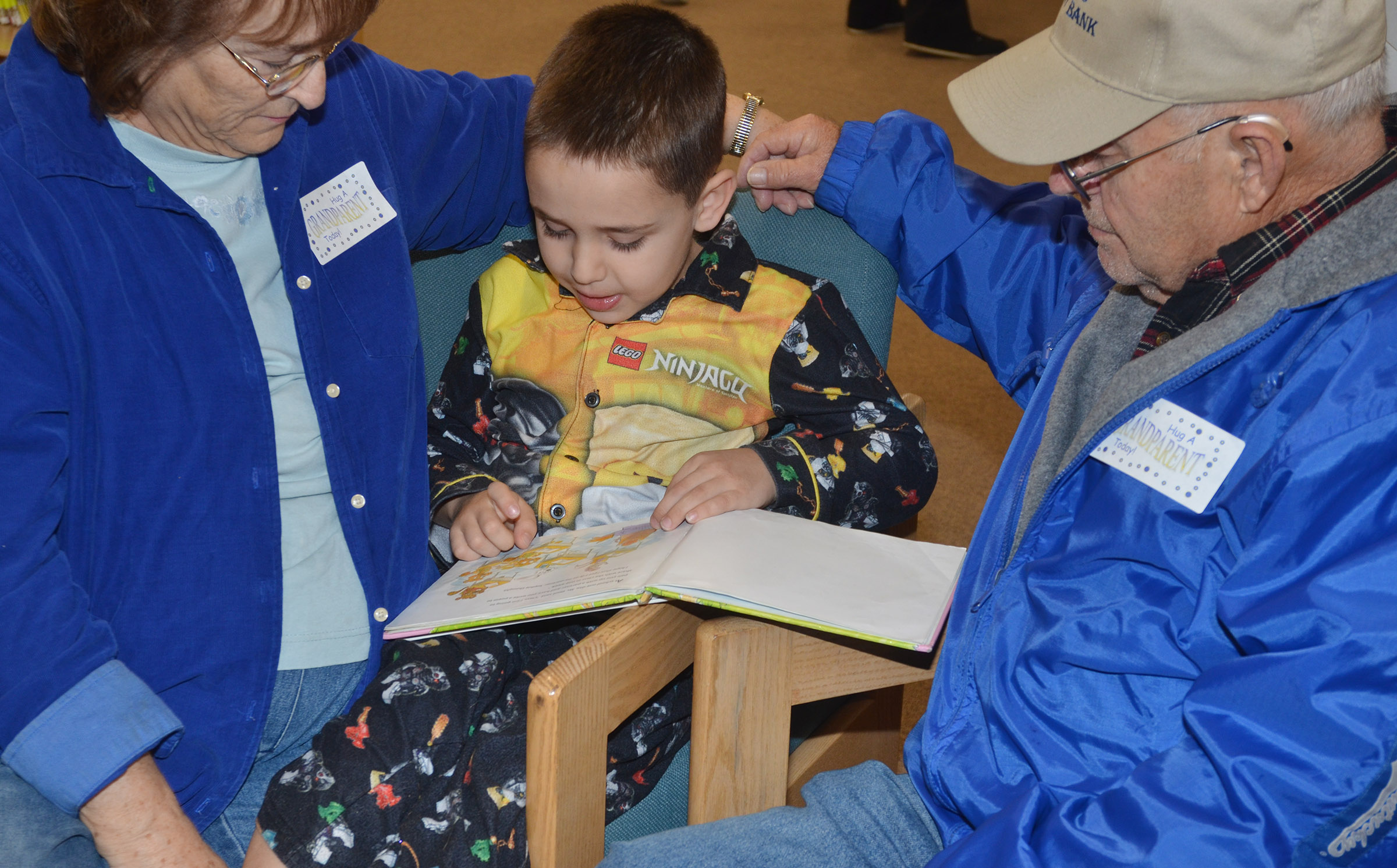 CES kindergartener Aaron Floyd reads with his grandparents, Betty and Carroll Floyd.