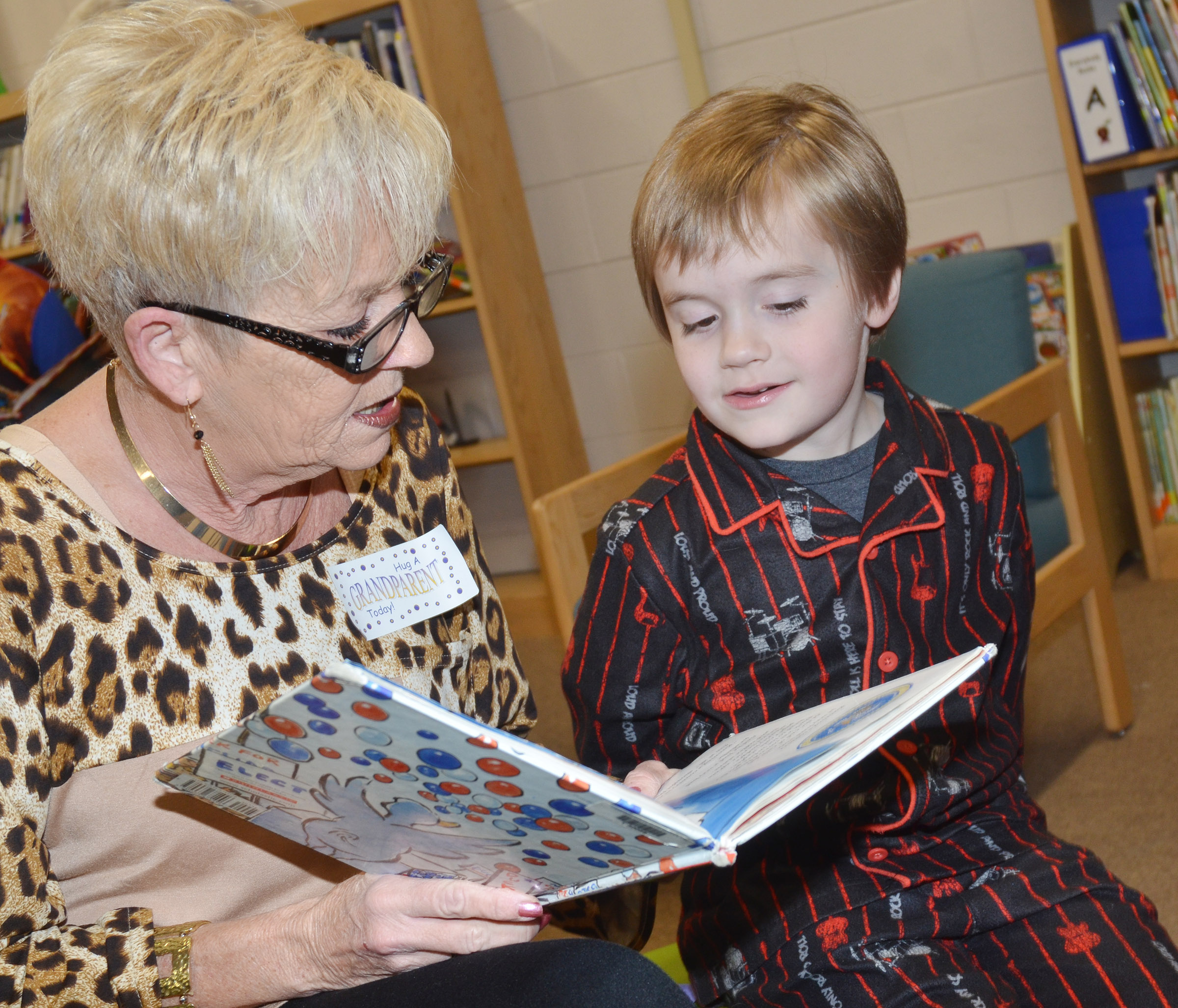 CES kindergartener Gavin Williams reads with his grandmother, Kathy Goodin.