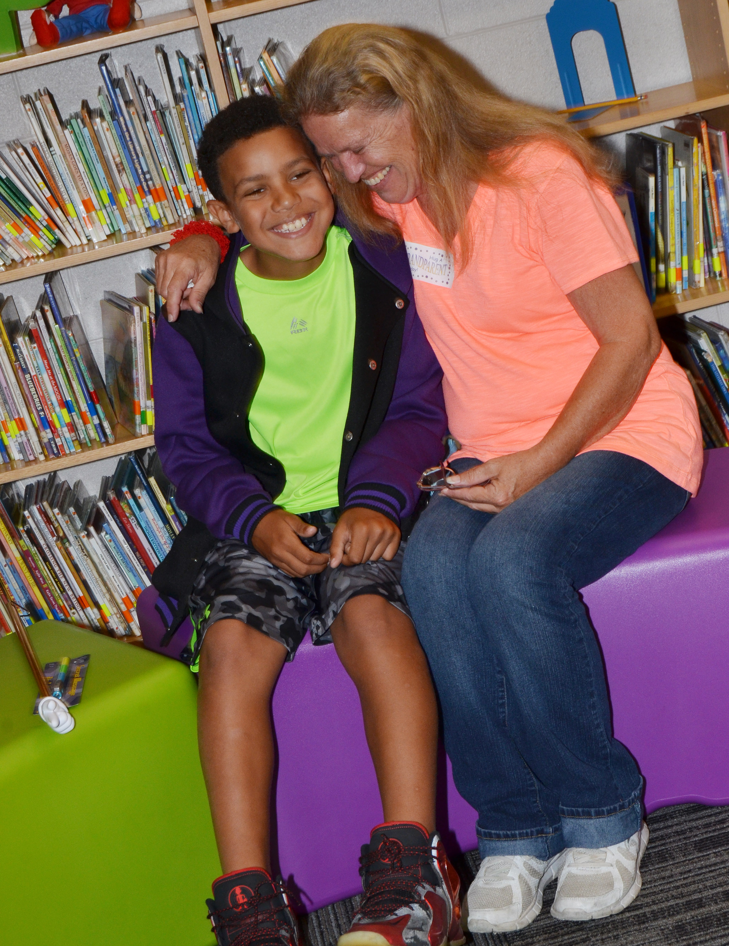 CES fourth-grader Christian Hart shares a laugh with his grandmother.