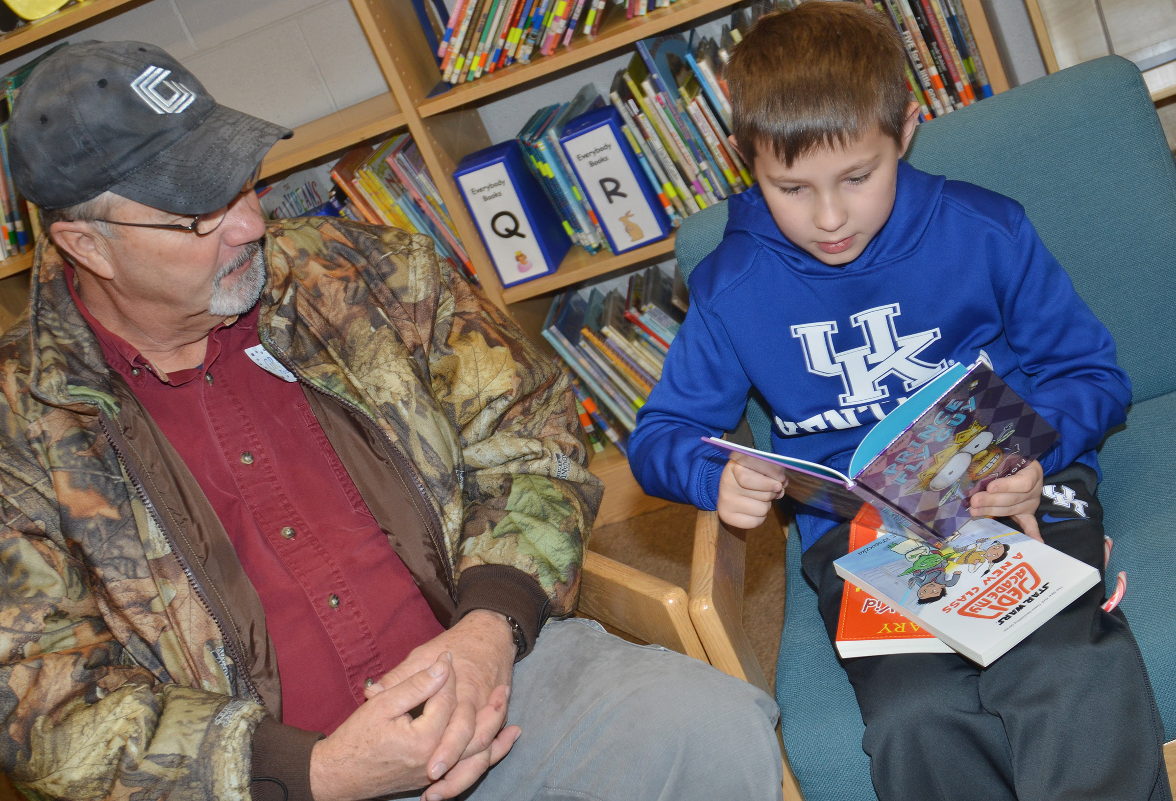 CES third-grader Grayson Dooley reads with his grandfather, Larry Stafford.