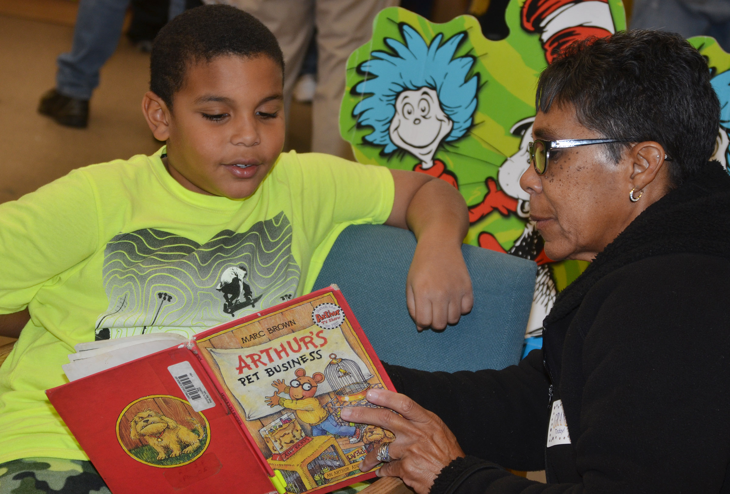 CES second-grader Zaemar Hoskins reads with his grandmother, Sharon Hoskins-Sanders.