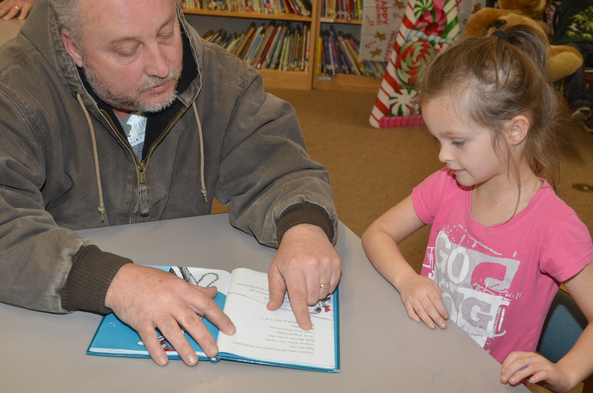 CES kindergartener Addison Perkins reads with her grandfather, Gary Murphy.