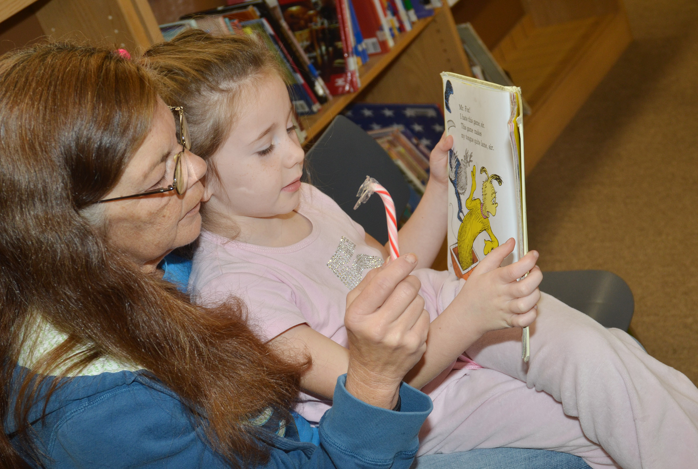 CES first-grader Kinsley Graham reads a book with her grandmother, Pam Morgan.