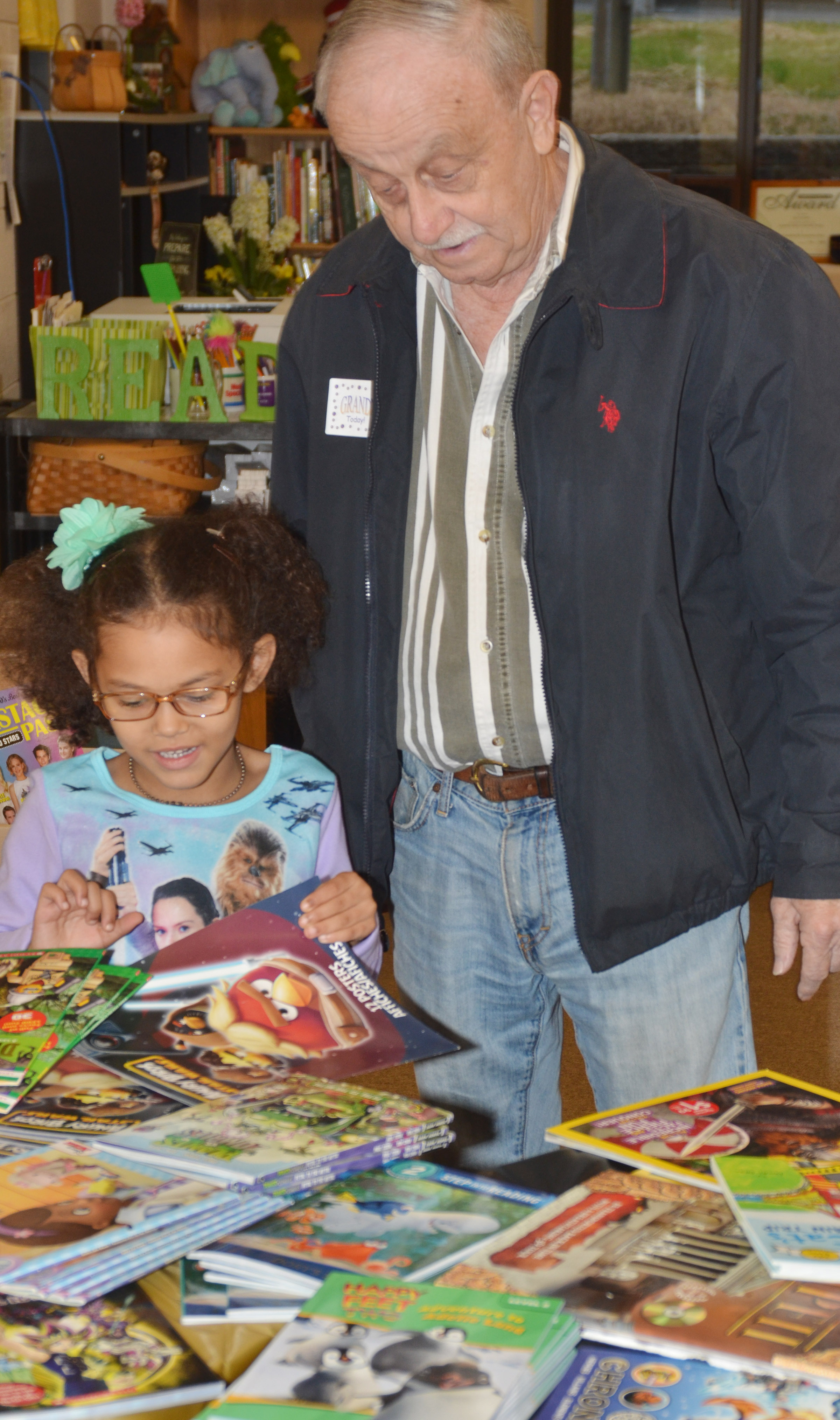 CES kindergartener Marlee Dickens shops for books with her grandfather, Jim Dickens.