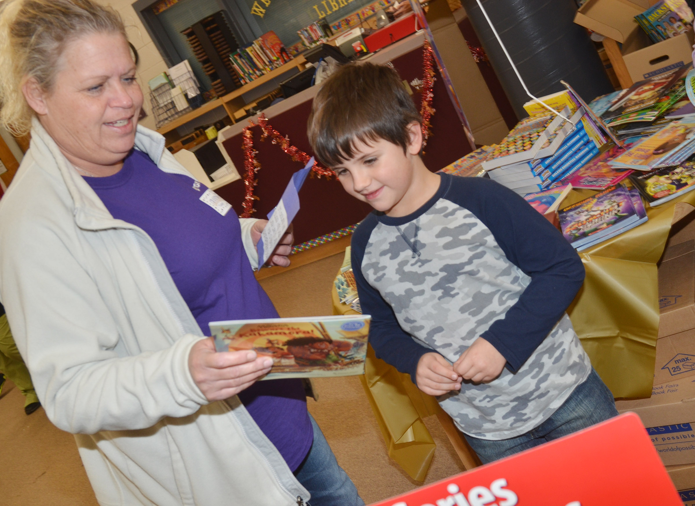 CES kindergartener Casen Meredith shops for books with his grandmother, Barbie Petrie.