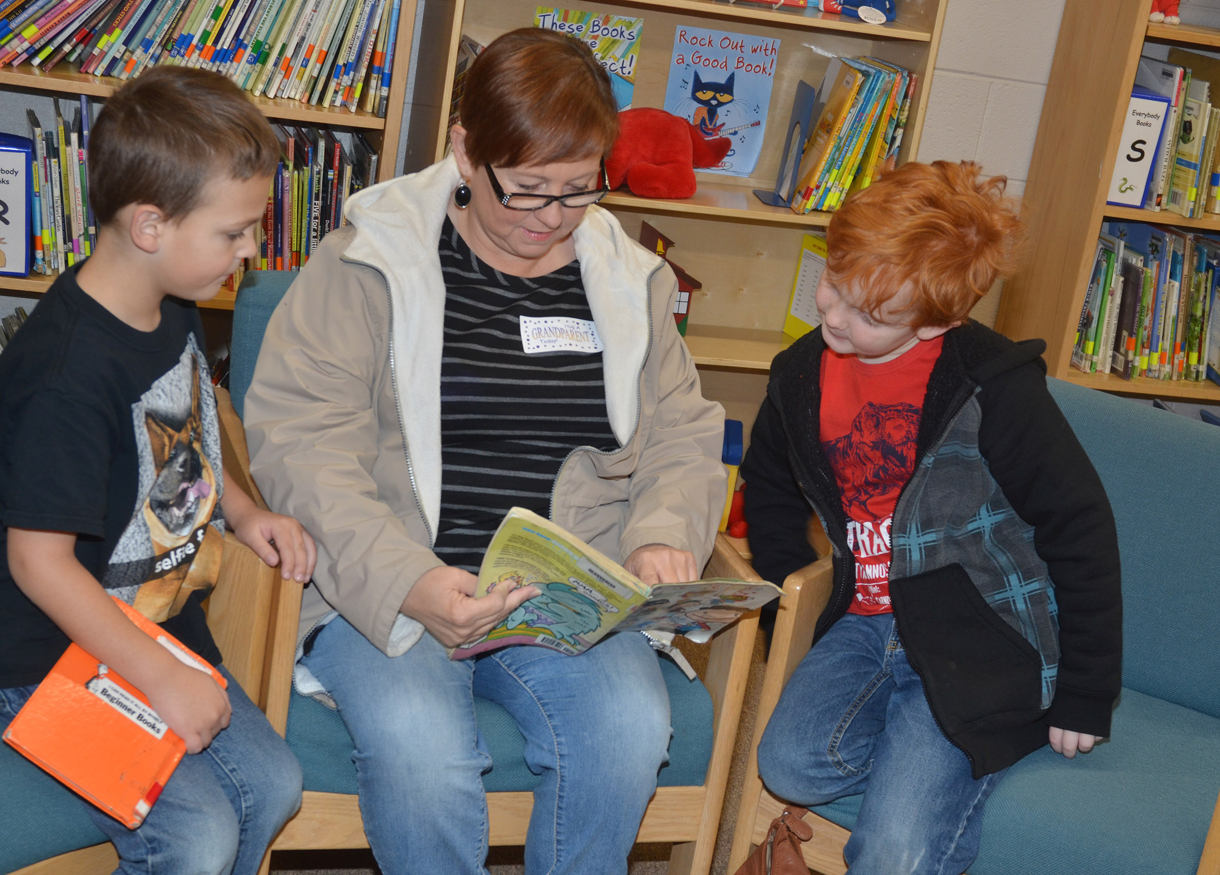 CES first-grader Brendan Martin, at left, and his brother, second-grader Gavin Martin, read with their grandmother, Kimberly Moore.