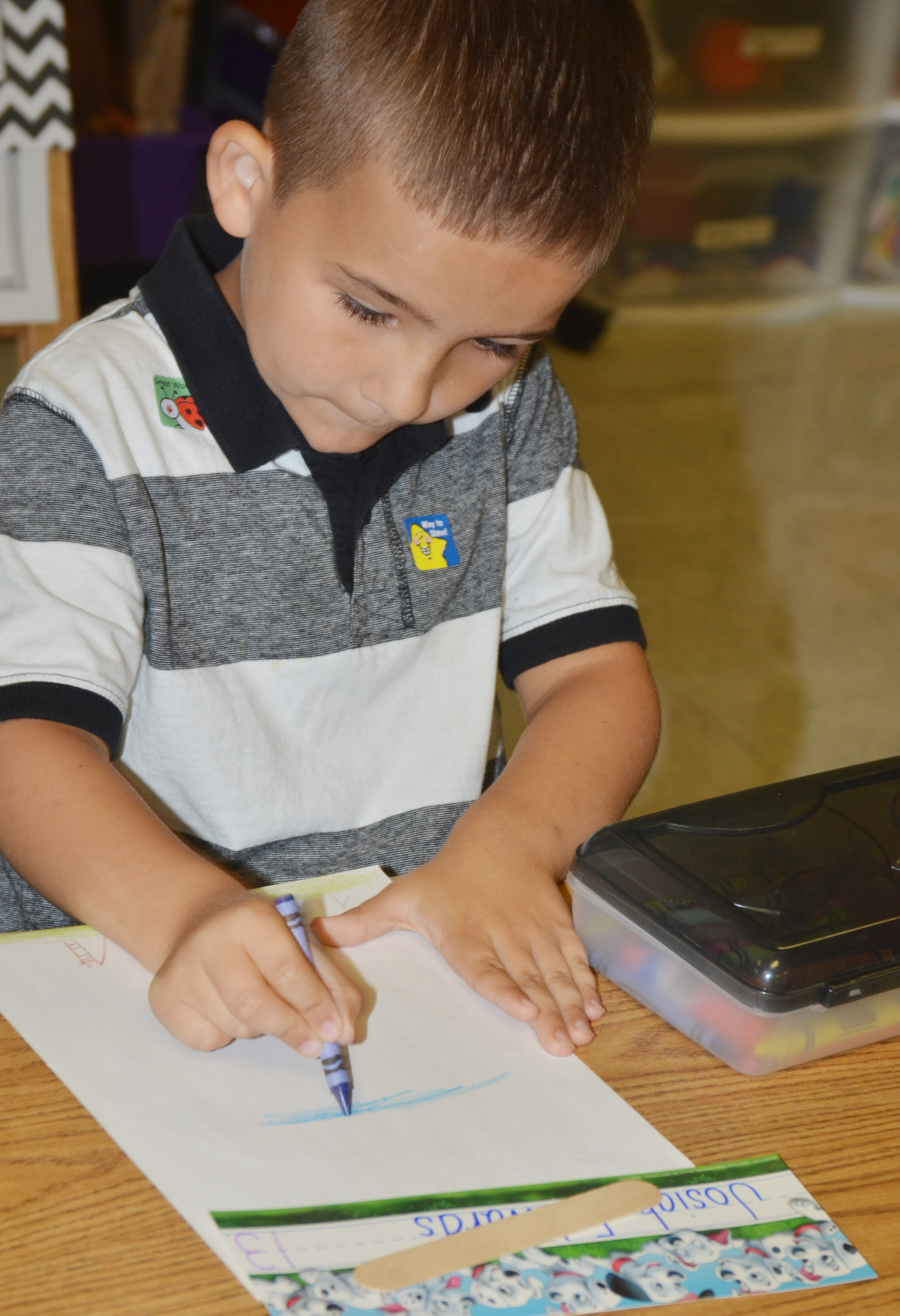 CES first-grader Josiah Edwards colors a picture.