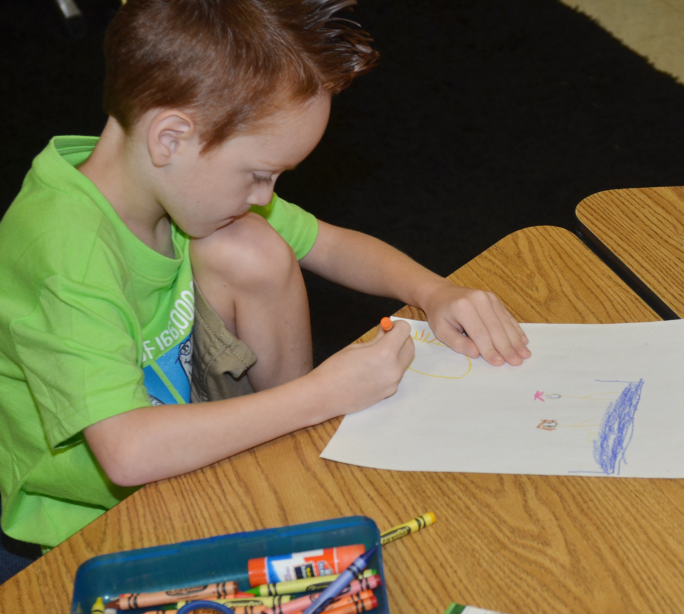 CES first-grader Carson Montes colors a picture.