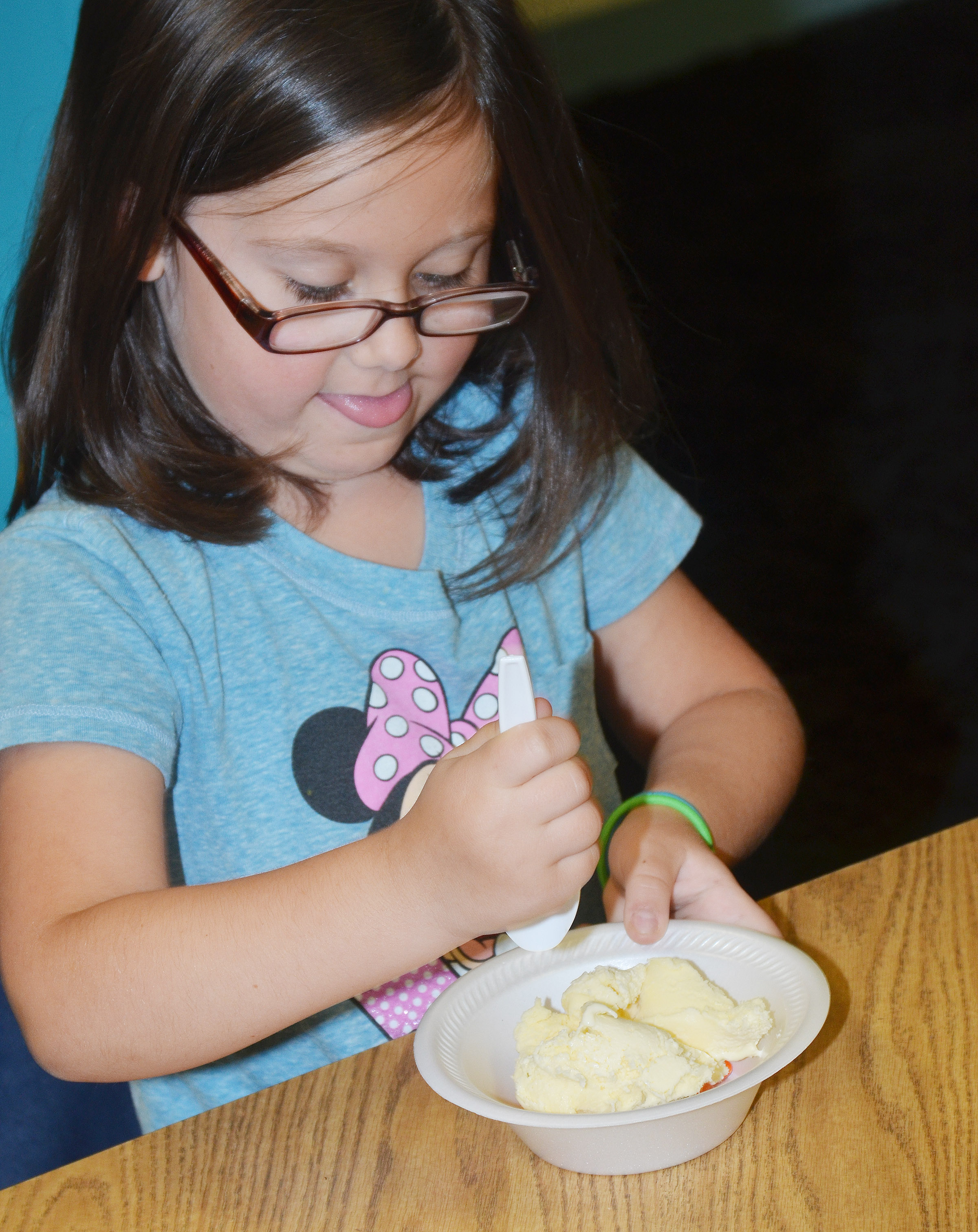 CES first-grader Trinity Clark enjoys her ice cream.