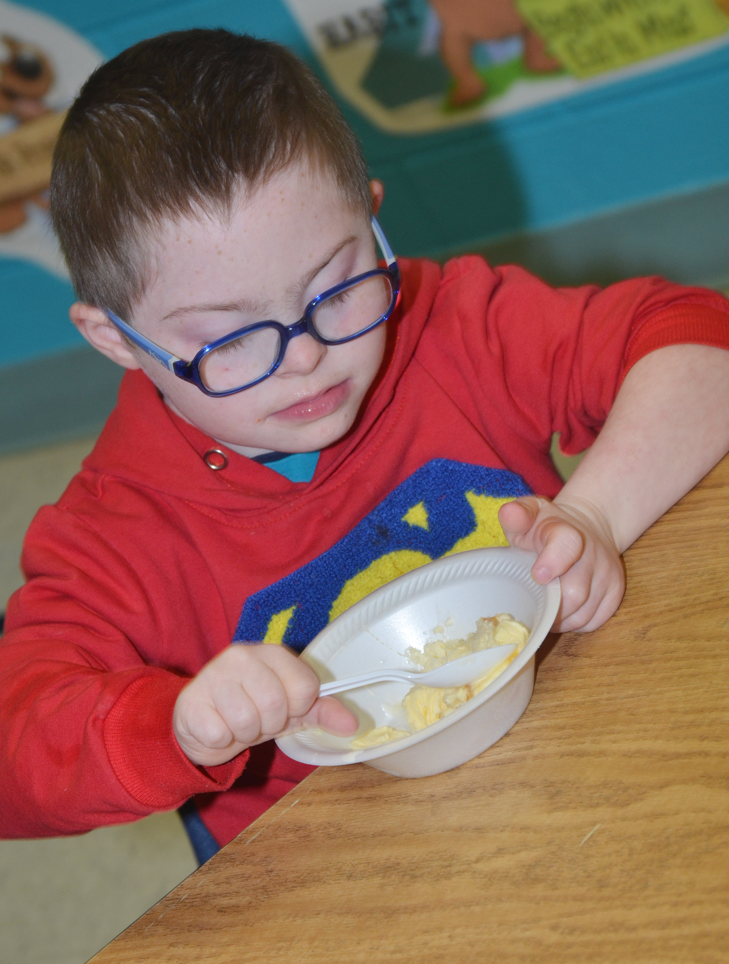 CES first-grader Nicholas Brunner eats his ice cream.