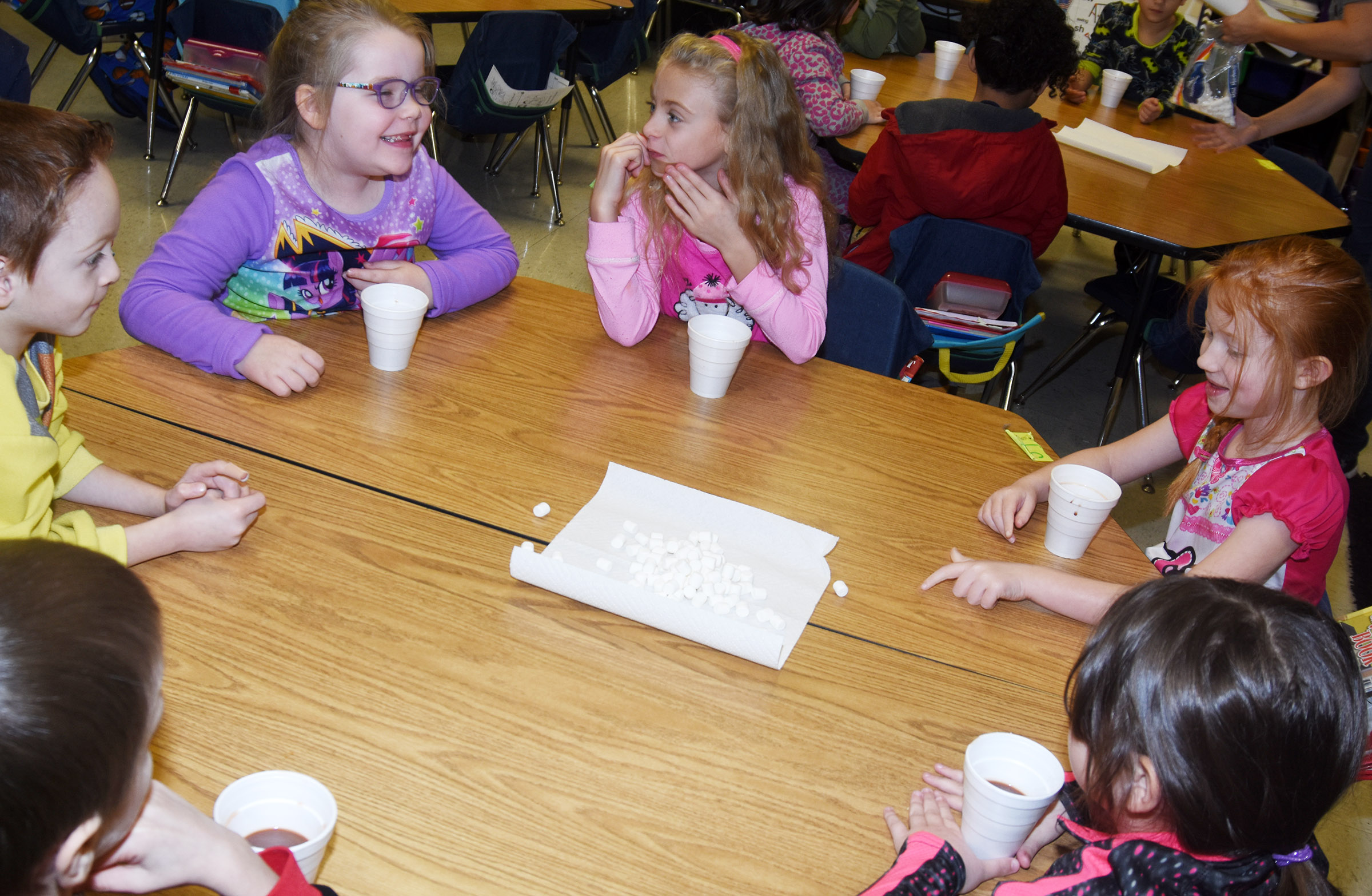 CES first-graders are excited to sample their hot chocolate. From left are Carson Montes, Cera Rooker, Aliyah Litsey and Bella Stout.