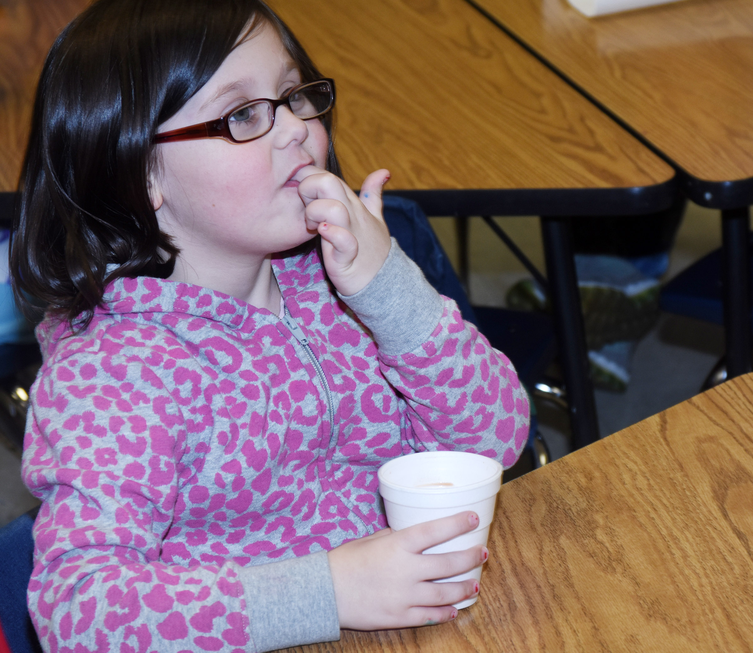 CES first-grader Trinity Clark samples her hot chocolate.