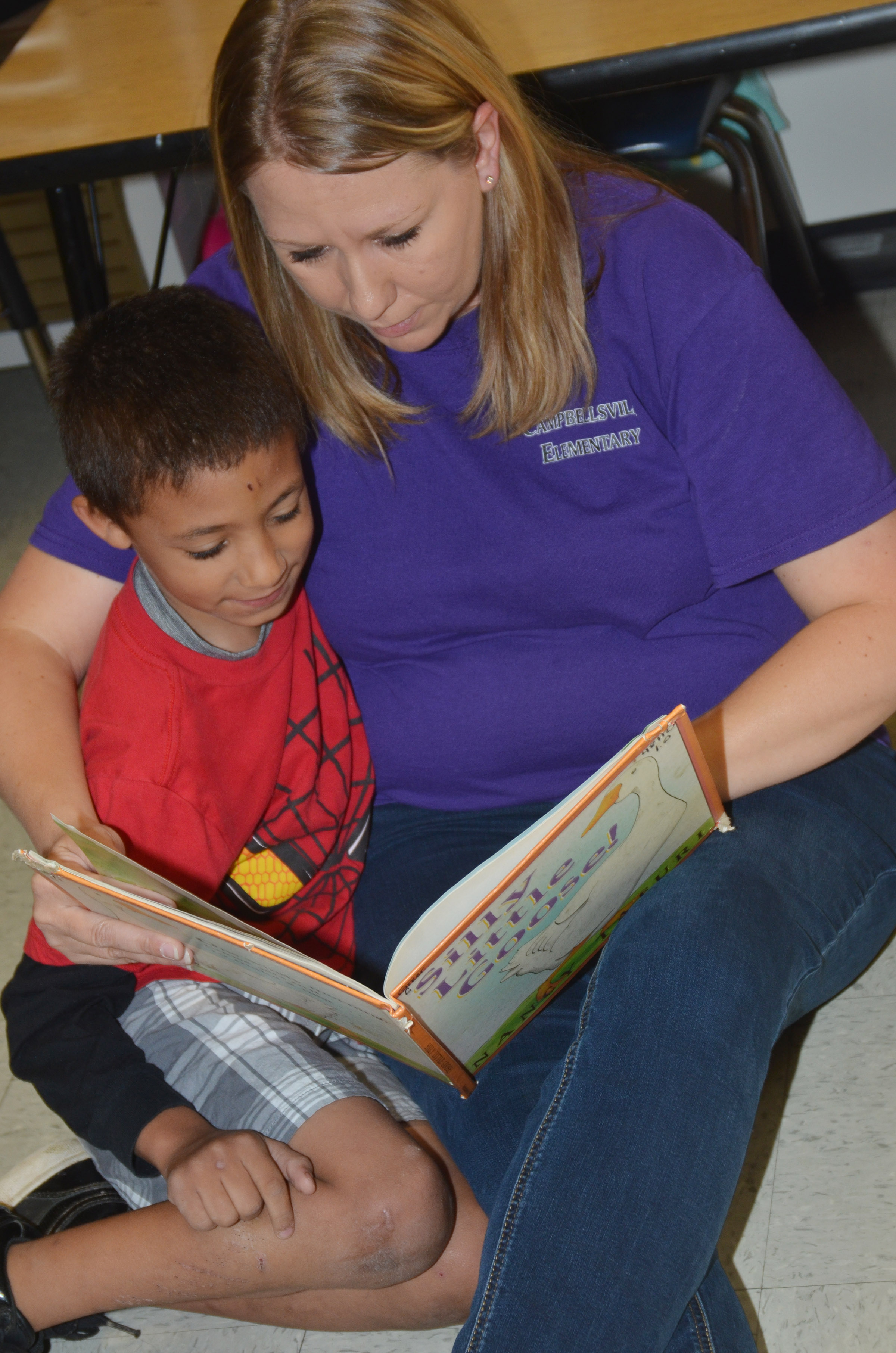 CES first-grade teacher Amanda Greer reads with Eli Williams.
