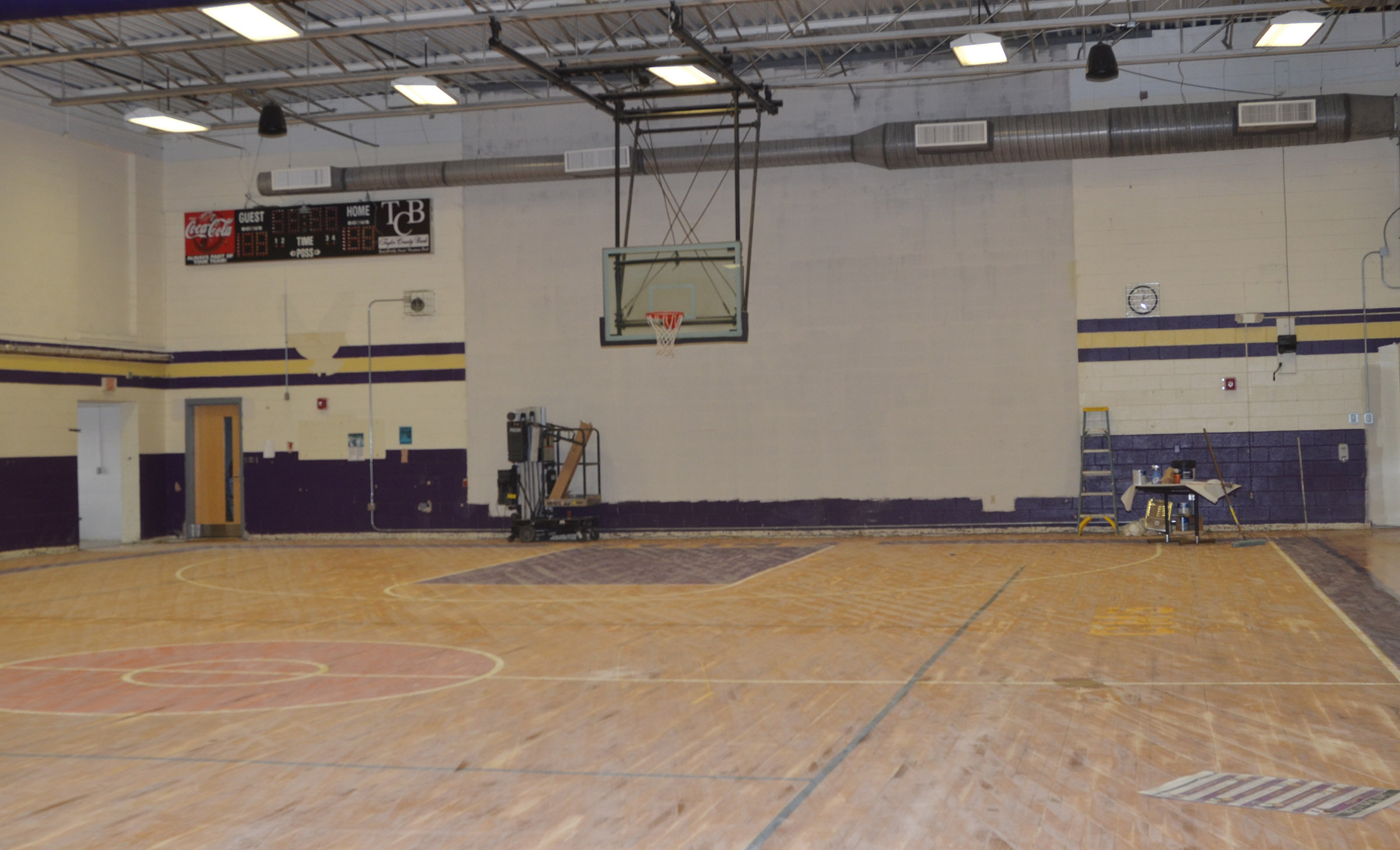 Work has begun to refinish the CES gymnasium floor and to repaint the walls.