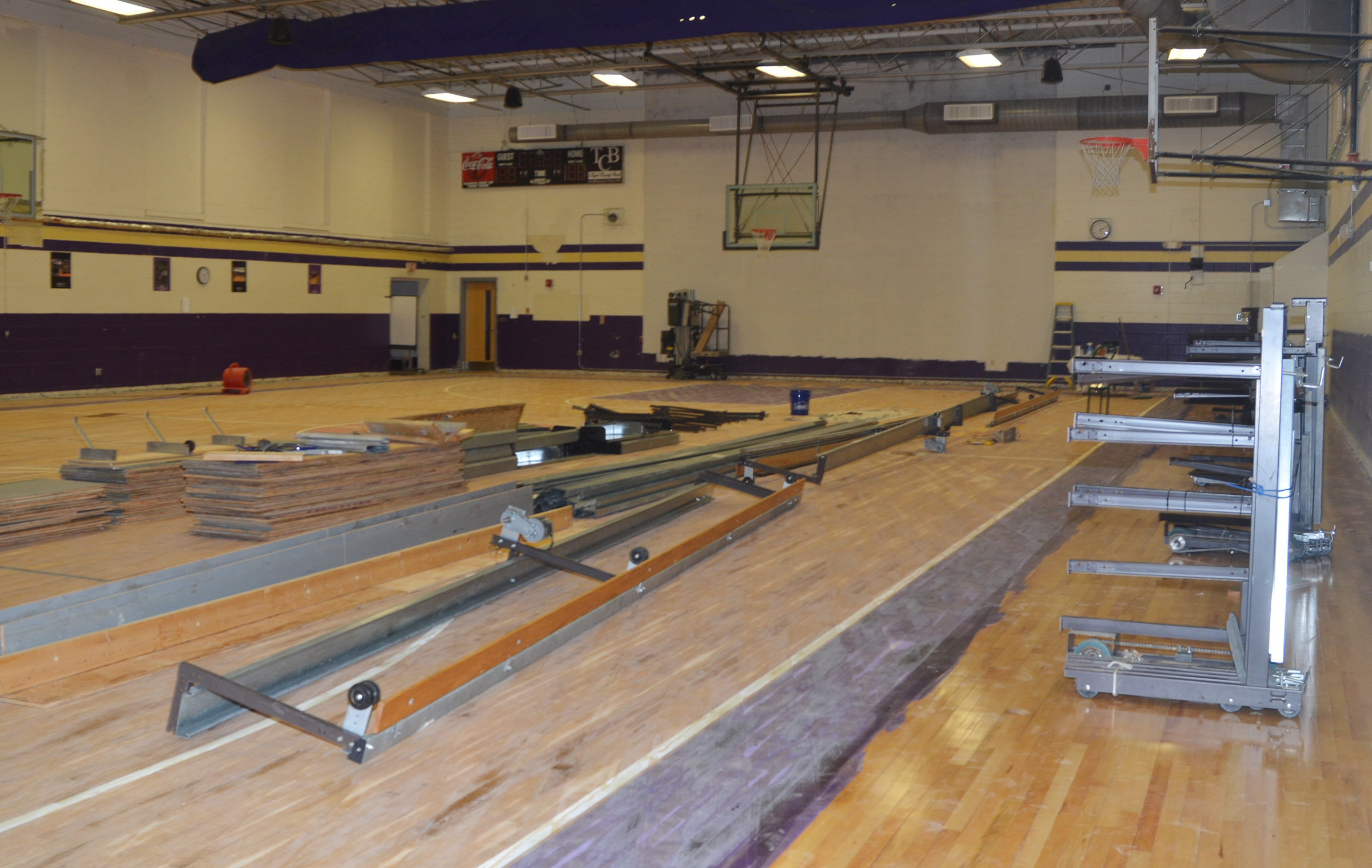Work has begun on installing new bleachers in the CES gymnasium.