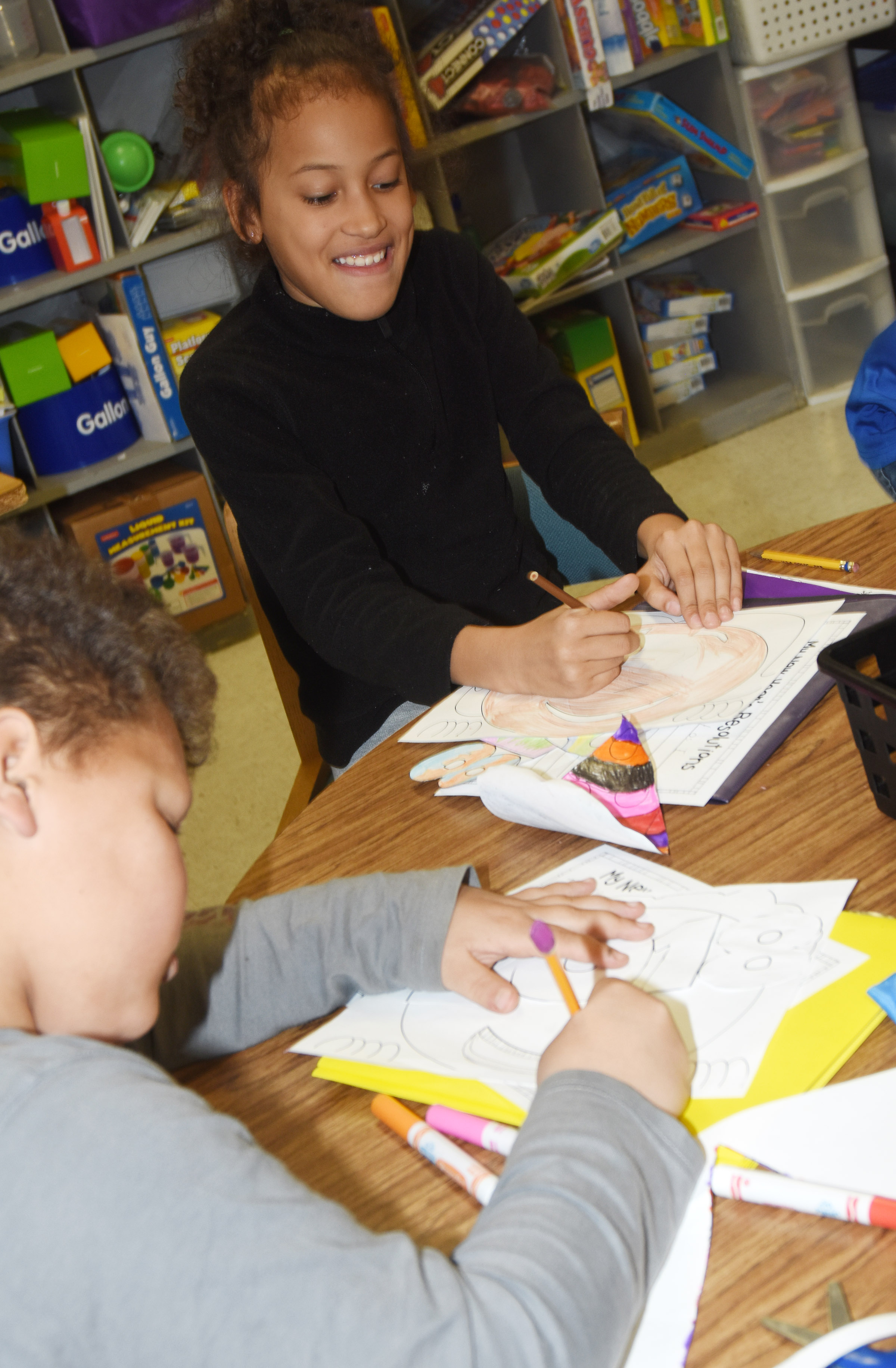 CES third-graders Drevonte Gurley and Yazlyn Sutton work on their New Year's resolution projects.