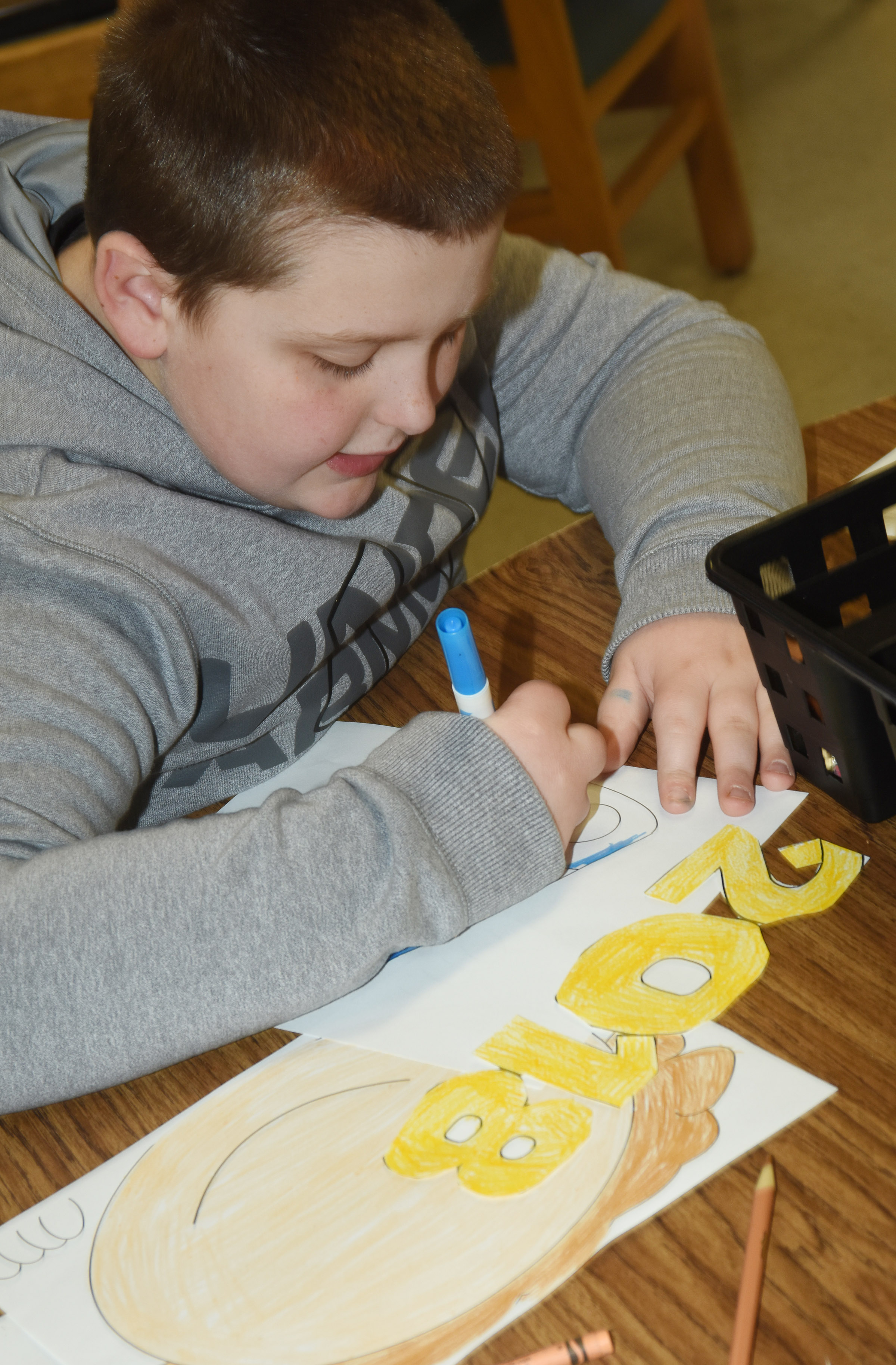 CES third-grader Braxton Tucker colors his New Year's resolution project.