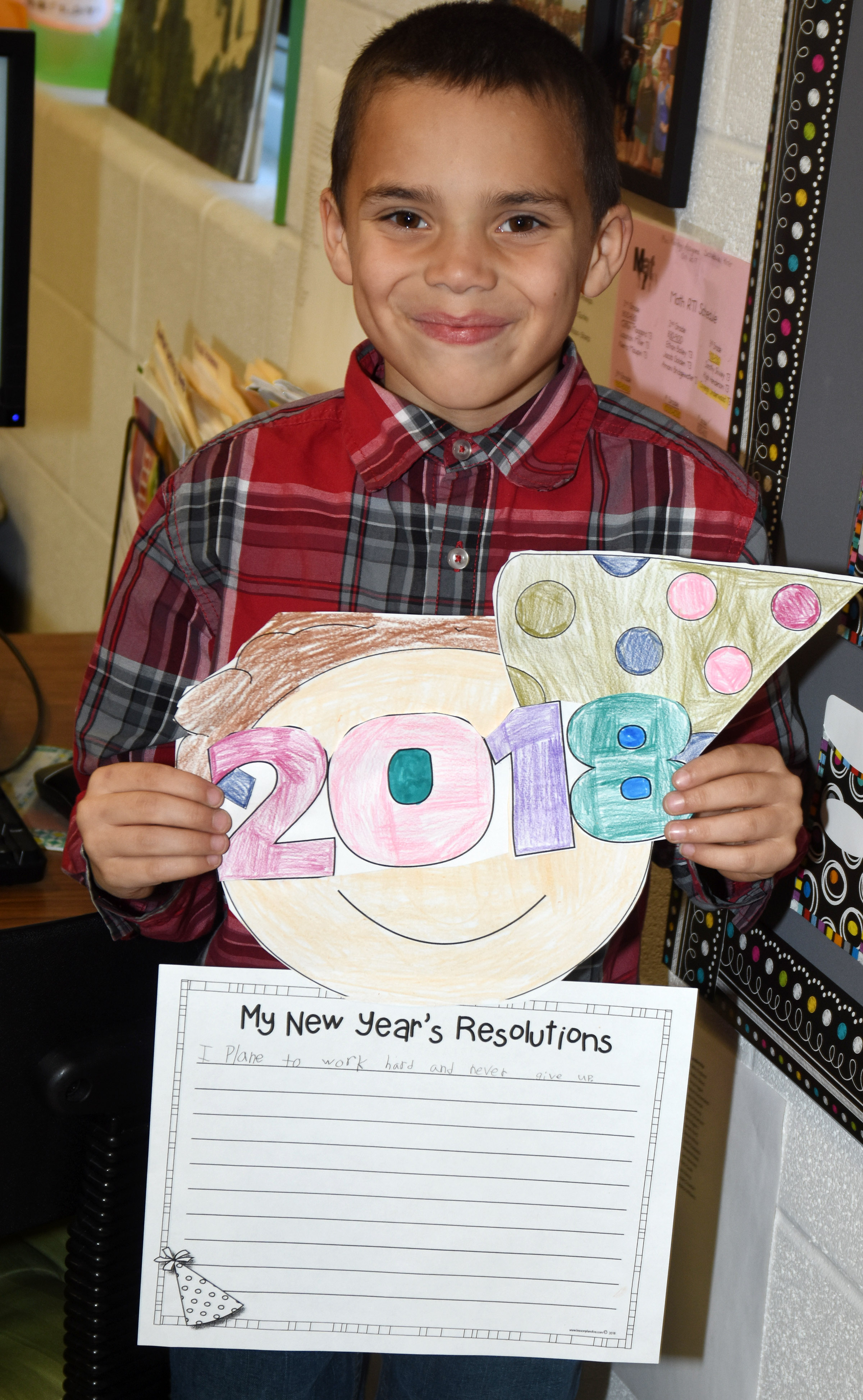 CES third-grader Donnaven Phillips holds his New Year's resolution project.