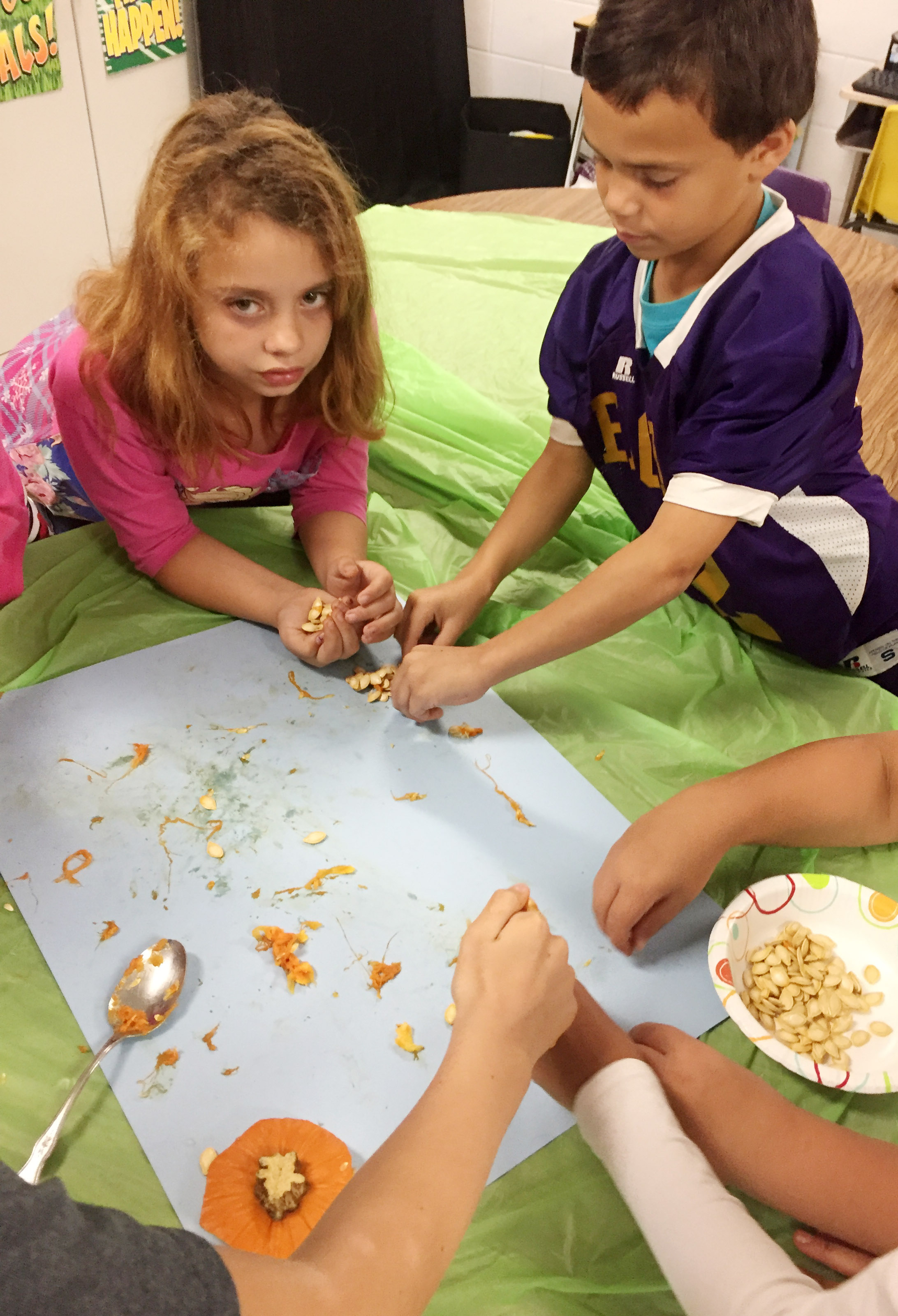 CES third-graders Angelina Babbs, at left, and Donnaven Phillips sort their pumpkin seeds.