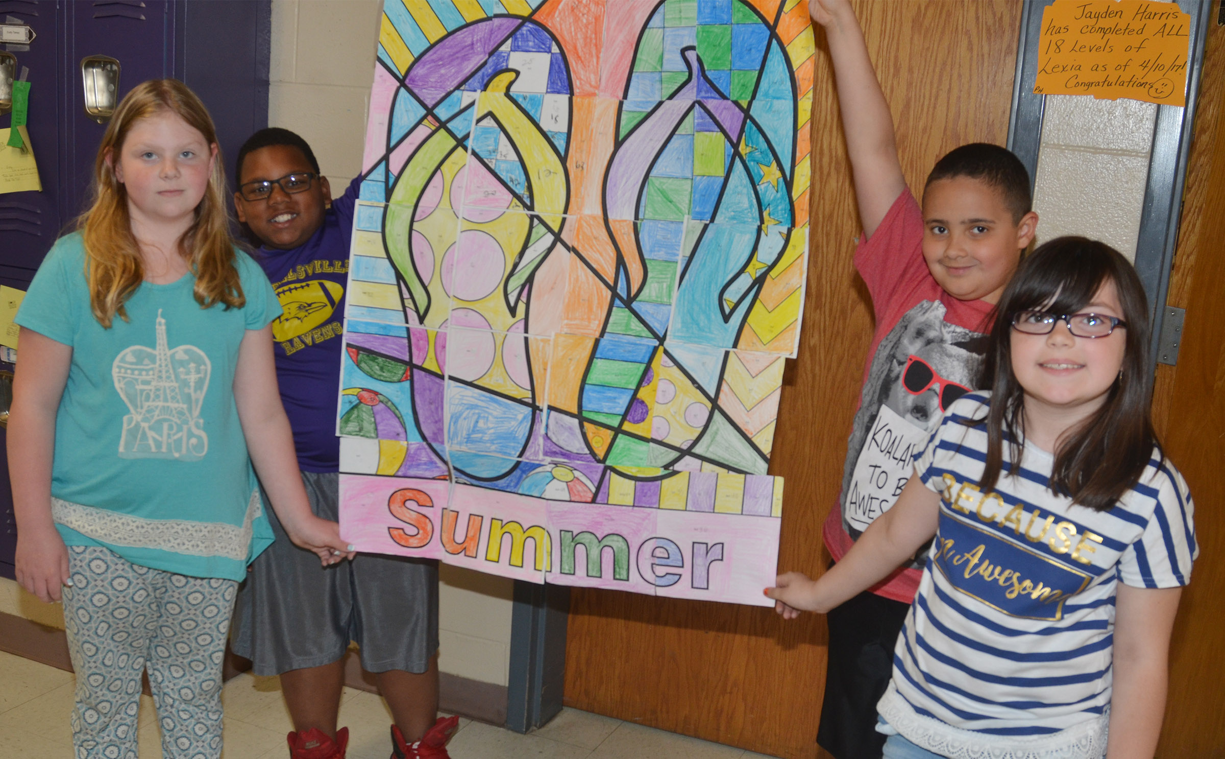 CES third-graders, from left, Alyssa Bennett, Malikiah Spurling, Tayshaun Hickman and Lauren Pace hold their class puzzle.