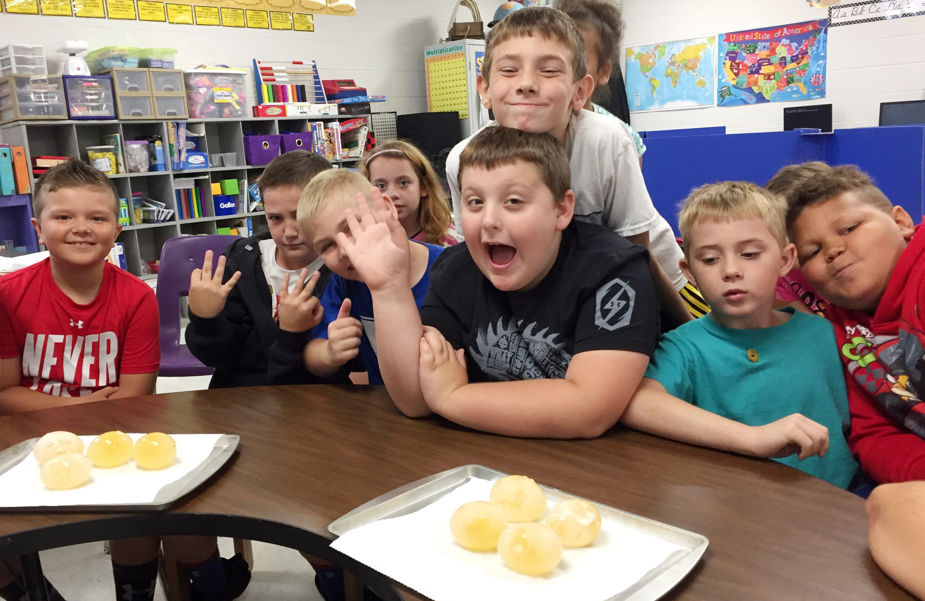 CES third-graders smile as they prepare to drop their eggs. From left are Cayton Lawhorn, Luke Adkins, Joseph Greer, Angelina Babbs, Braxton Tucker, Aidan Wilson, Devyn Tingle and Drevonte Gurley.