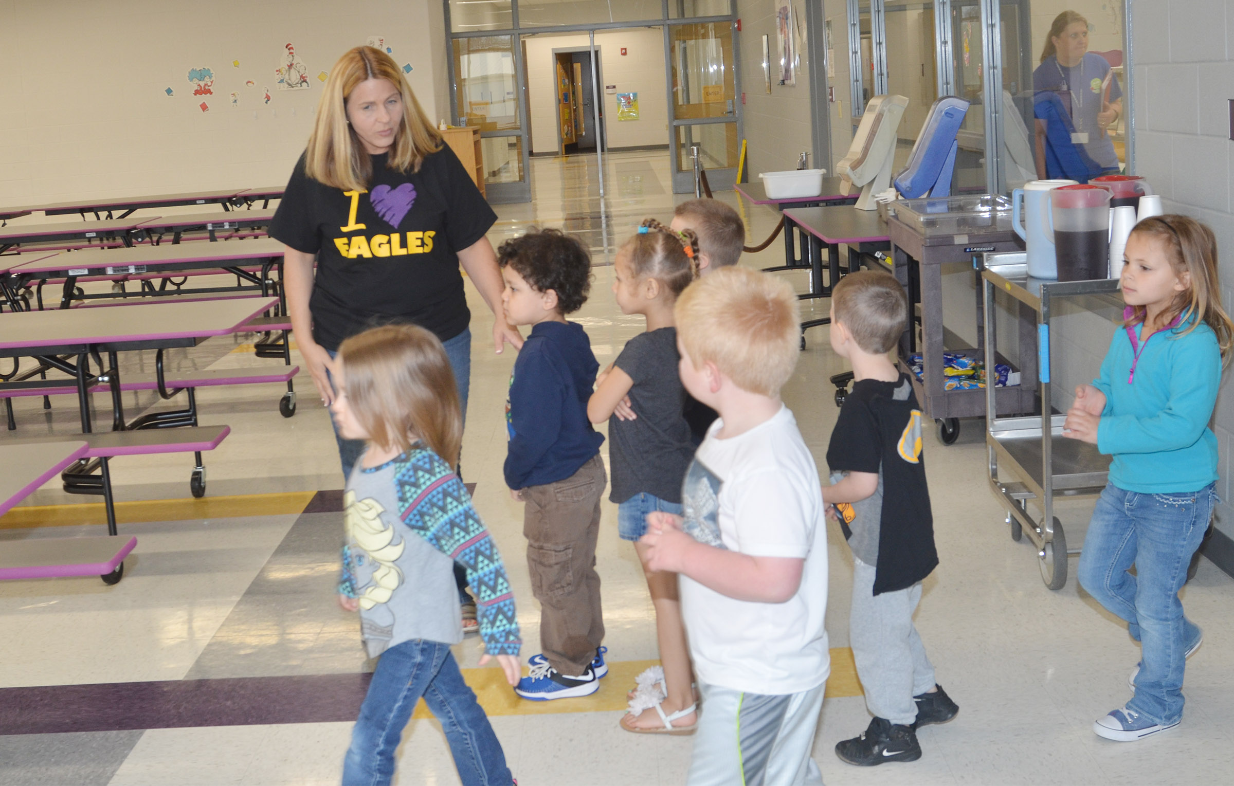 CES Guidance Counselor Sonya Orberson leads Campbellsville/Taylor County Head Start students through the school's new cafeteria.