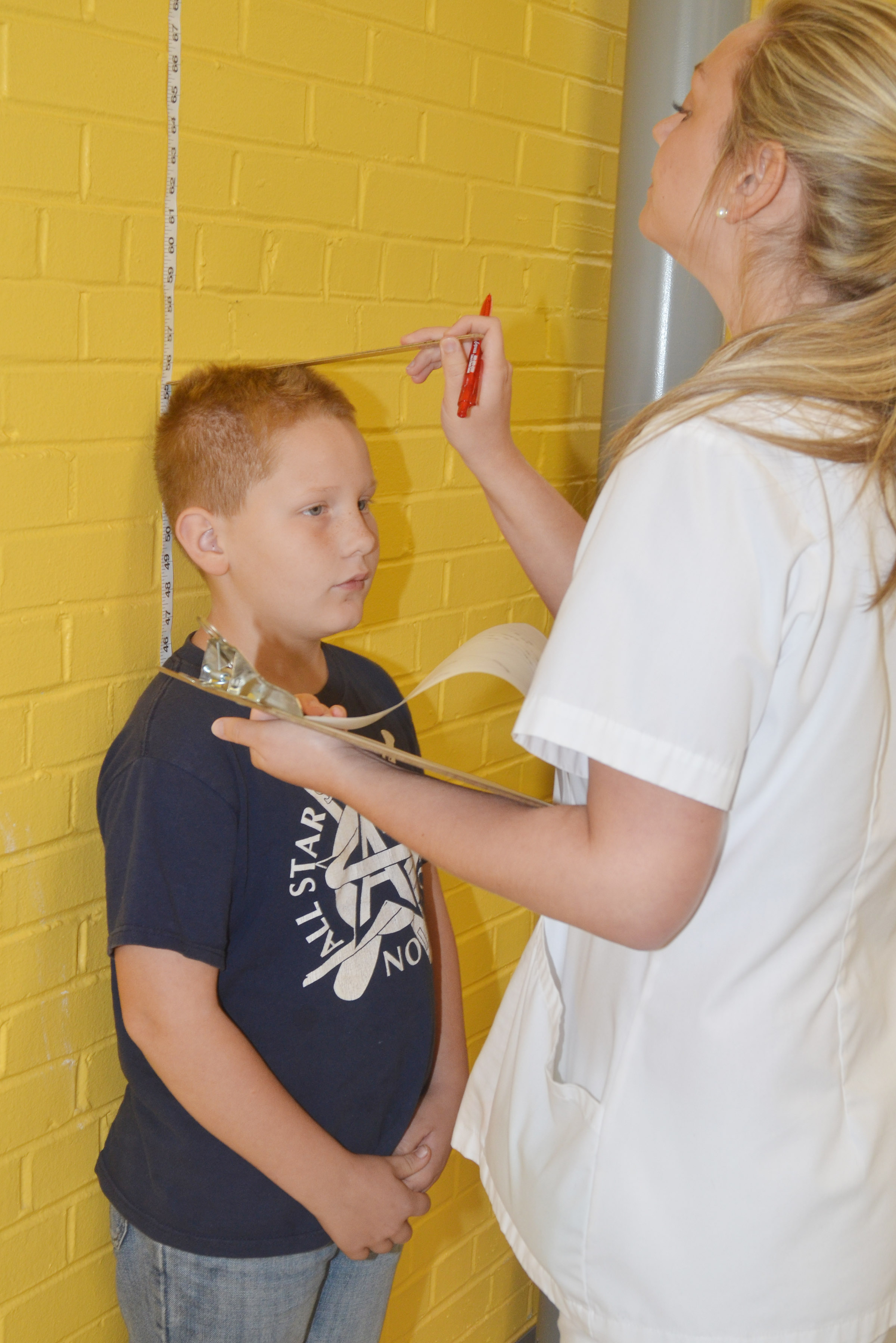 CES fourth-grader Isaiah Jeffries has his height measured by Campbellsville University nursing student Amelia Miller.