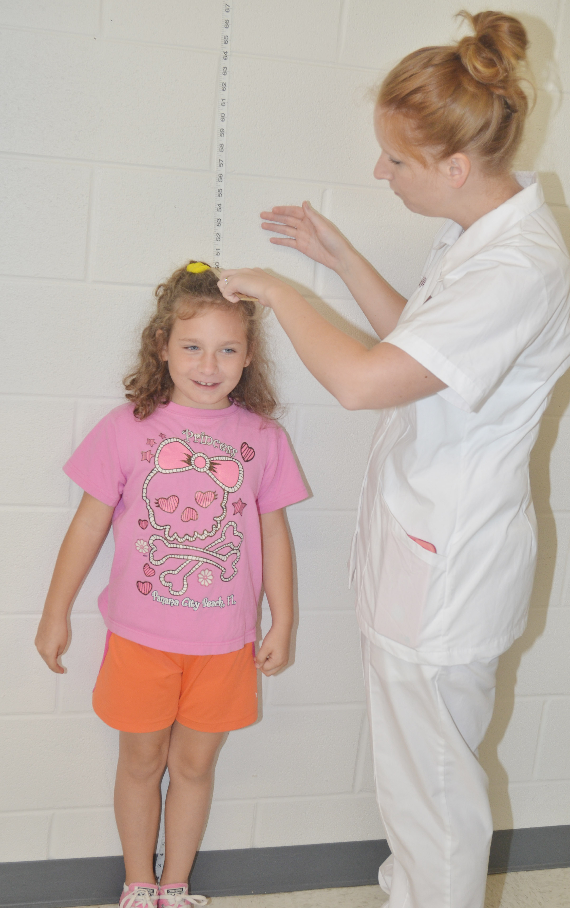 CES fourth-grader Aliyah Burton has her height measured by Campbellsville University nursing student Danielle Hundley.