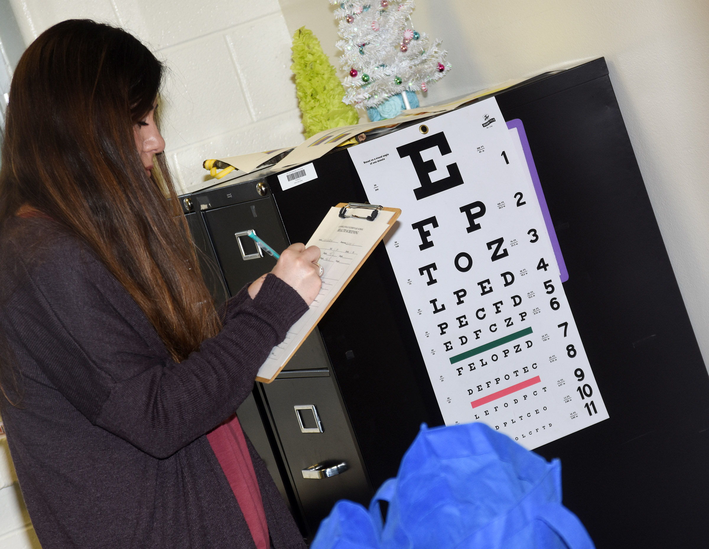 CES Guidance Assistant Courtney Mills administers an eye exam.
