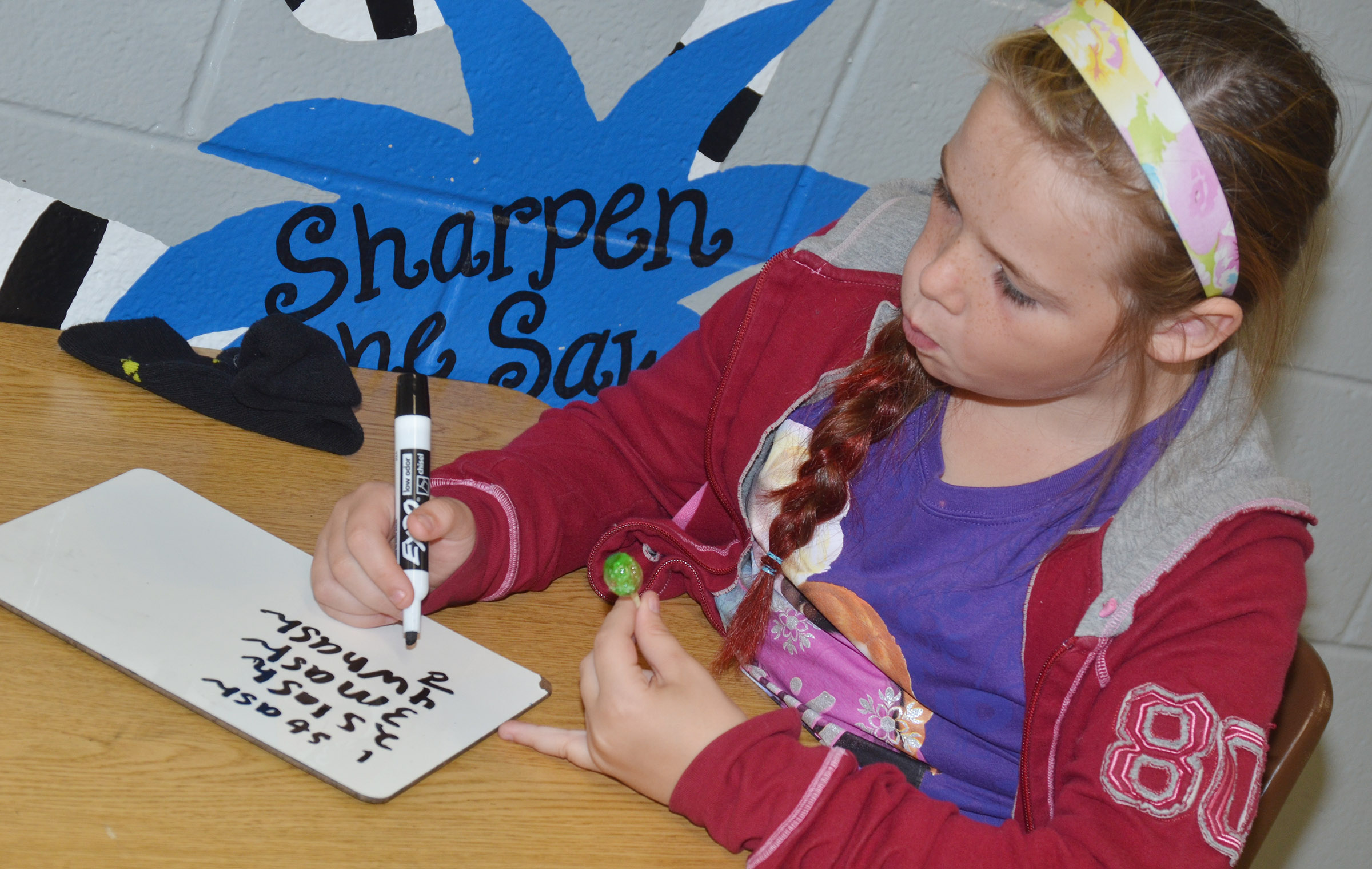 "CES third-grader Cayleigh Underwood writes words that contain ""sh."""